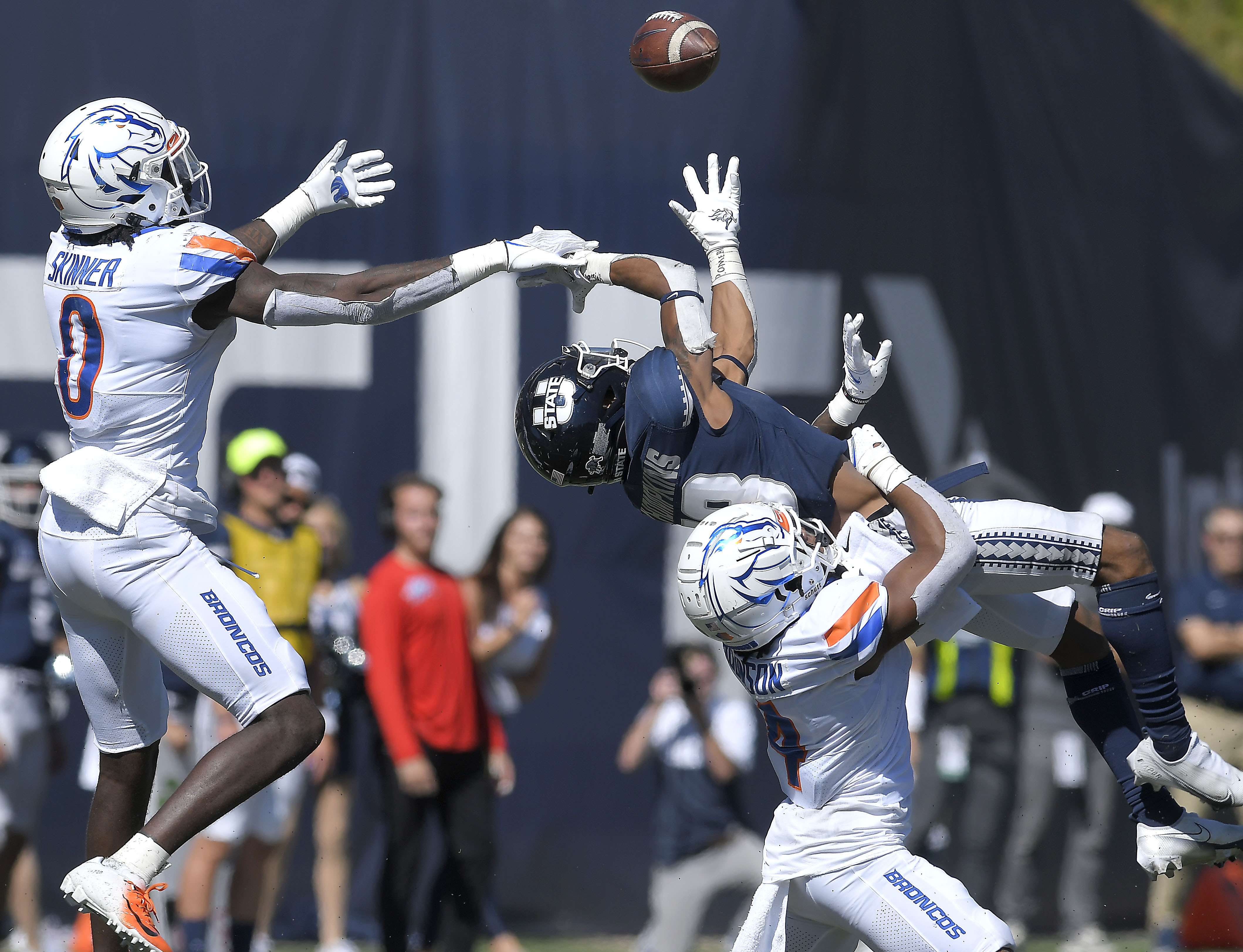 Boise State safety JL Skinner (0) and safety Rodney Robinson break up a pass intended for Utah State wide receiver Deven Thompkins (13).