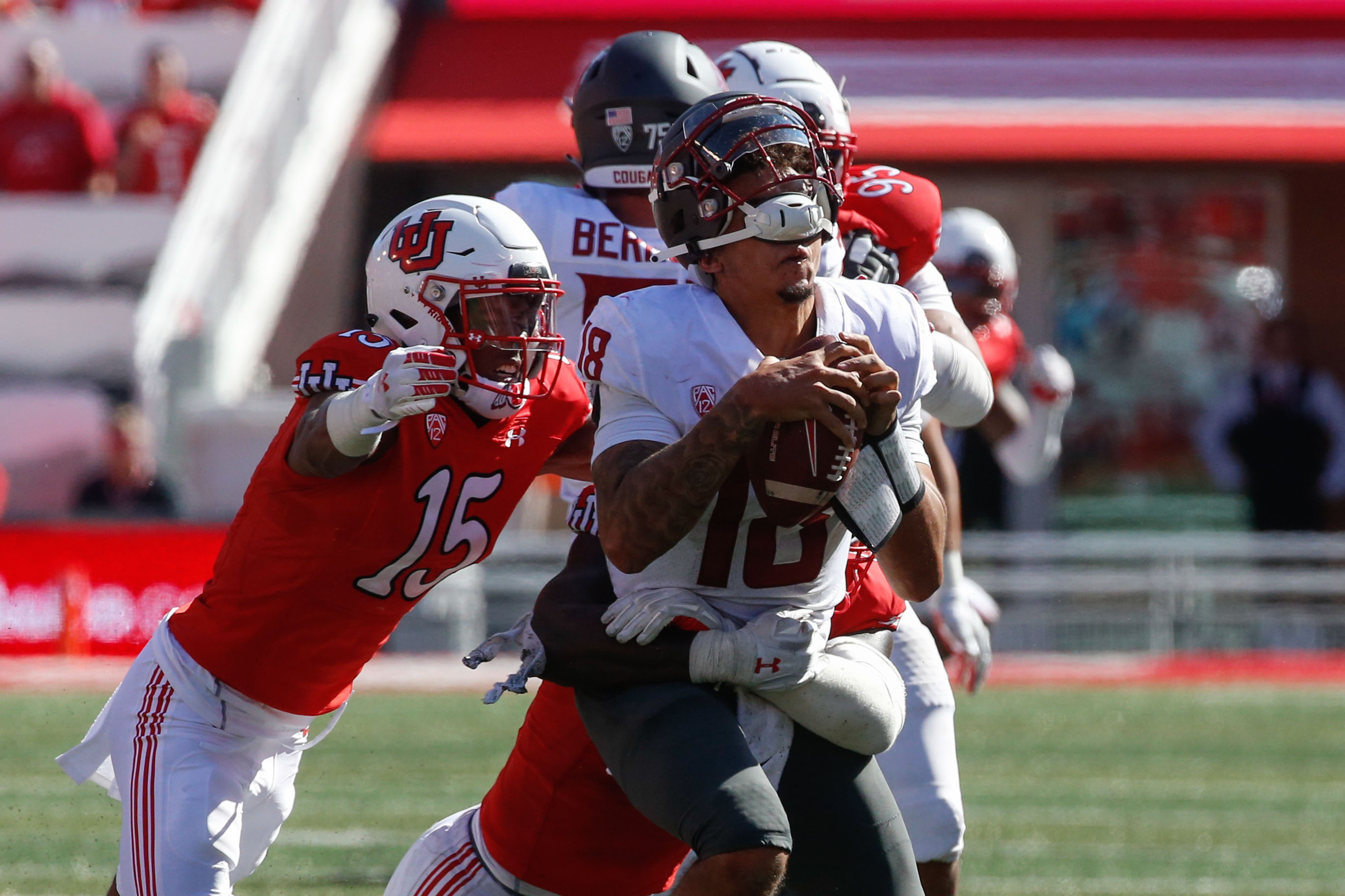 Washington State quarterback Jarrett Guarantano's (18) helmet comes off while he's tackled by Utah defenders during an NCAA college football game at Rice-Eccles Stadium on Saturday, Sept. 25, 2021 in Salt Lake City. Utah won the game 24-13.