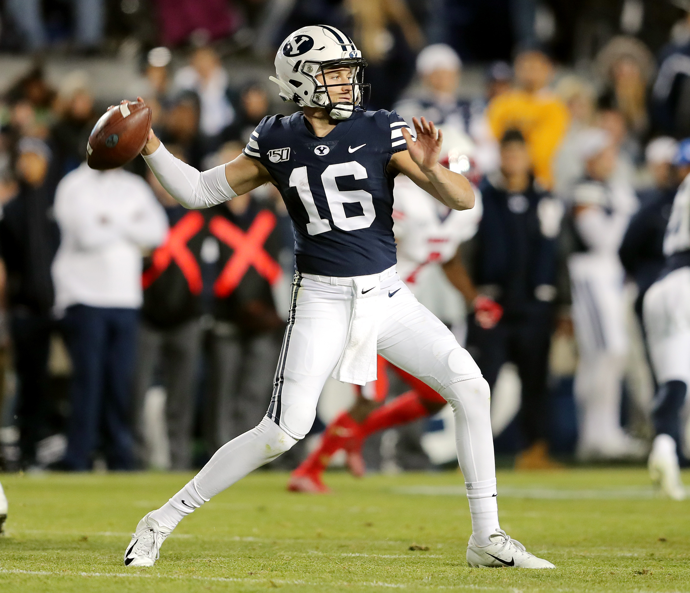 Brigham Young Cougars quarterback Baylor Romney (16) sets to pass as BYU and Liberty play an NCAA football game in Provo, Utah on Saturday, Nov. 9, 2019. BYU won 31-24.