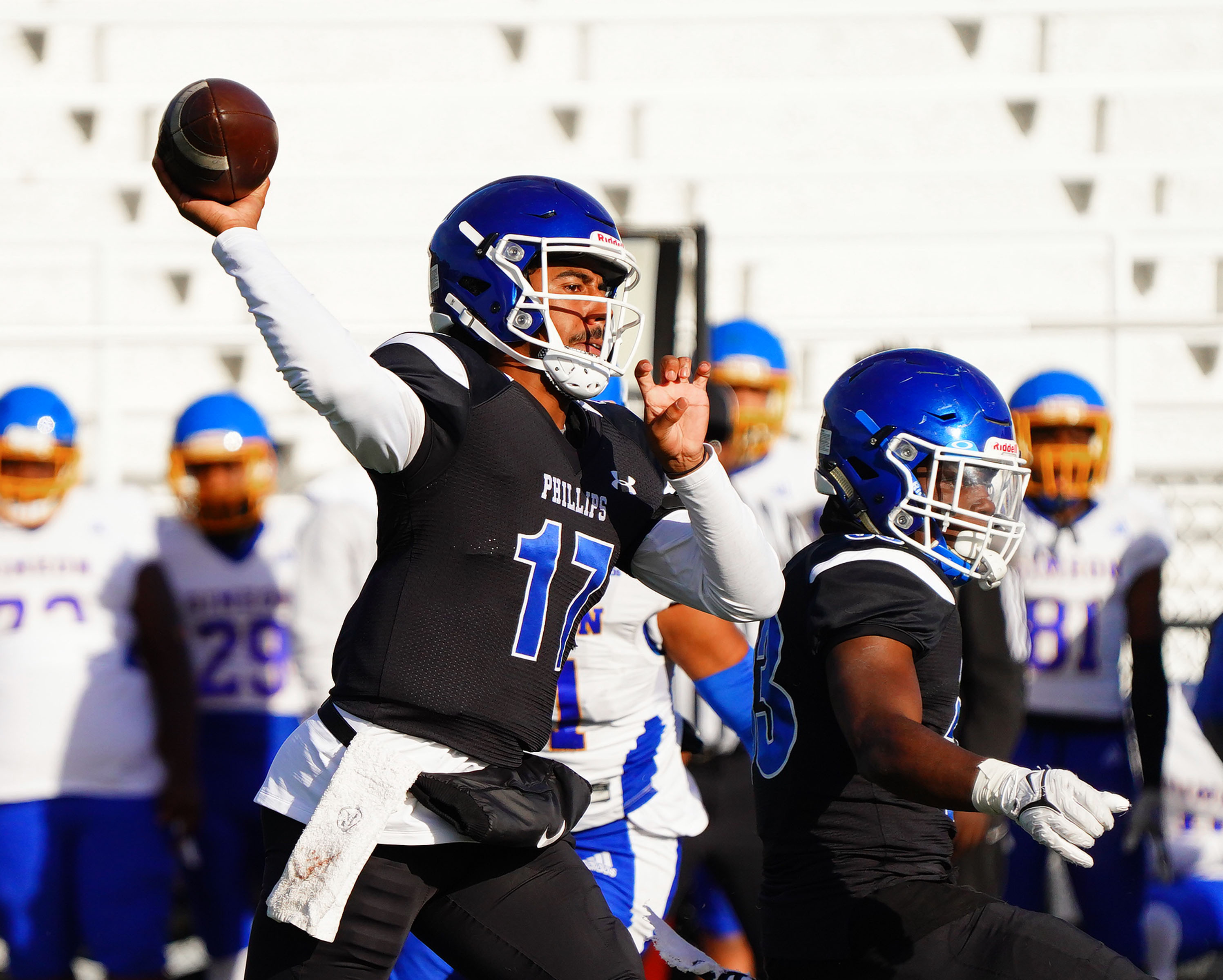 Phillips's Tyler Turner (17) looks for a receiver against Simeon.