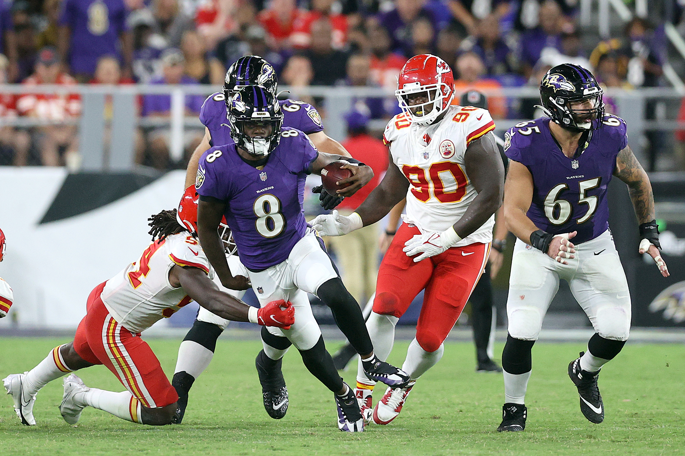 Quarterback Lamar Jackson #8 of the Baltimore Ravens is tackled by linebacker Nick Bolton #54 of the Kansas City Chiefs in the second half at M&T Bank Stadium on September 19, 2021 in Baltimore, Maryland.