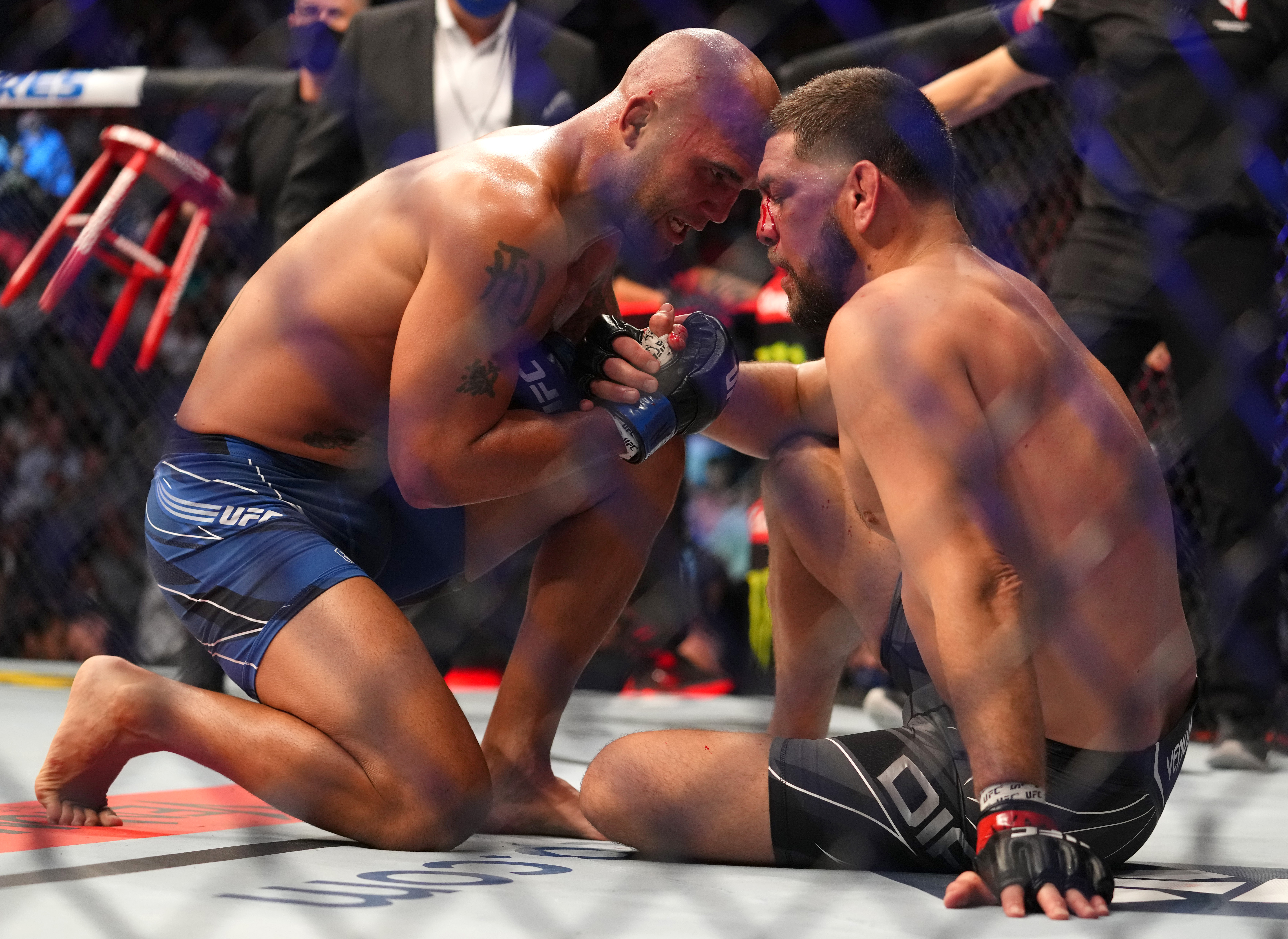 Robbie Lawler speaks with Nick Diaz at the end of their fight at UFC 266.
