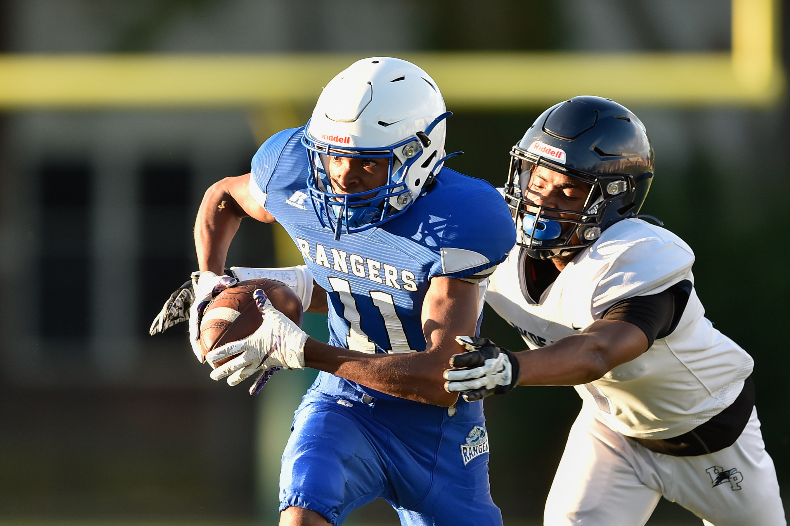 Mather's Terence Young (11) runs the ball after intercepting a pass intended for Hyde Park's Jeremiah Smith (7).