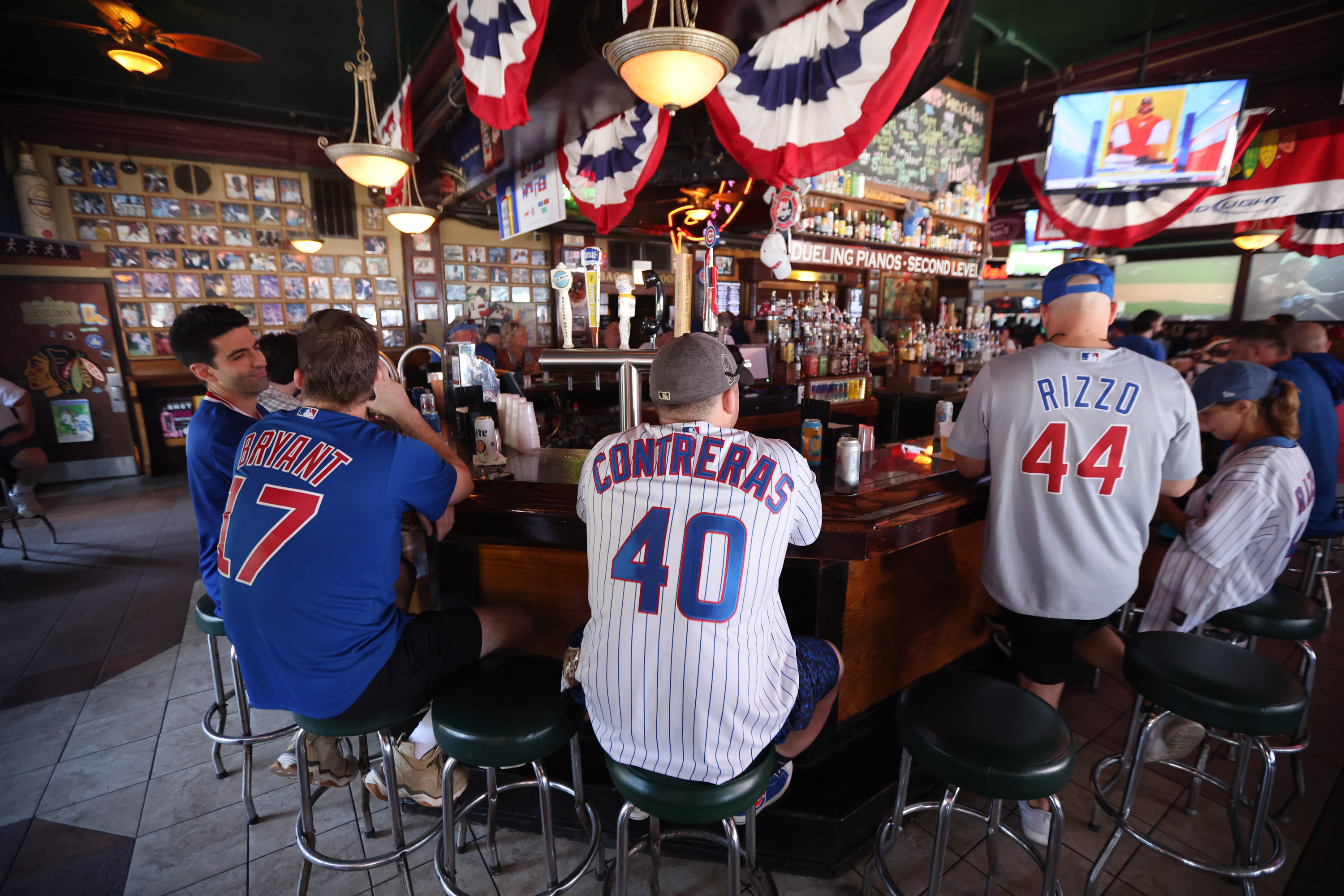 Baseball fans congregate at Sluggers sports bar across from Wrigley Field before the start of the nearly-sold-out matchup between the Chicago Cubs and the St. Louis Cardinals on June 11. In June, Chicago and the rest of the state of Illinois lifted nearly all COVID-19 restrictions, allowing for no capacity limits for bars, restaurants, gyms, or other large venues and no social distancing requirements.