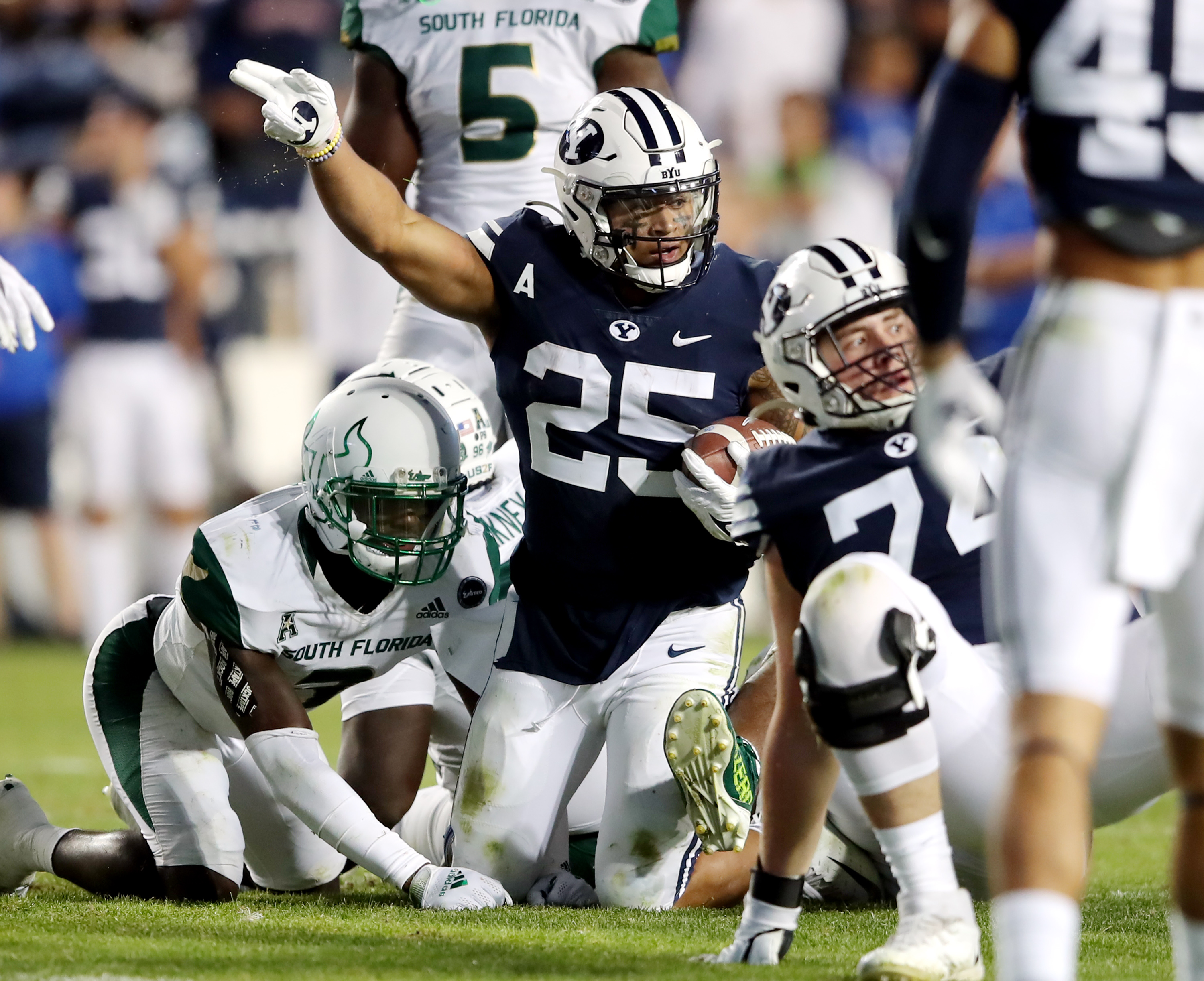 Brigham Young Cougars running back Tyler Allgeier (25) motions first down after a run as BYU and USF play a college football game.