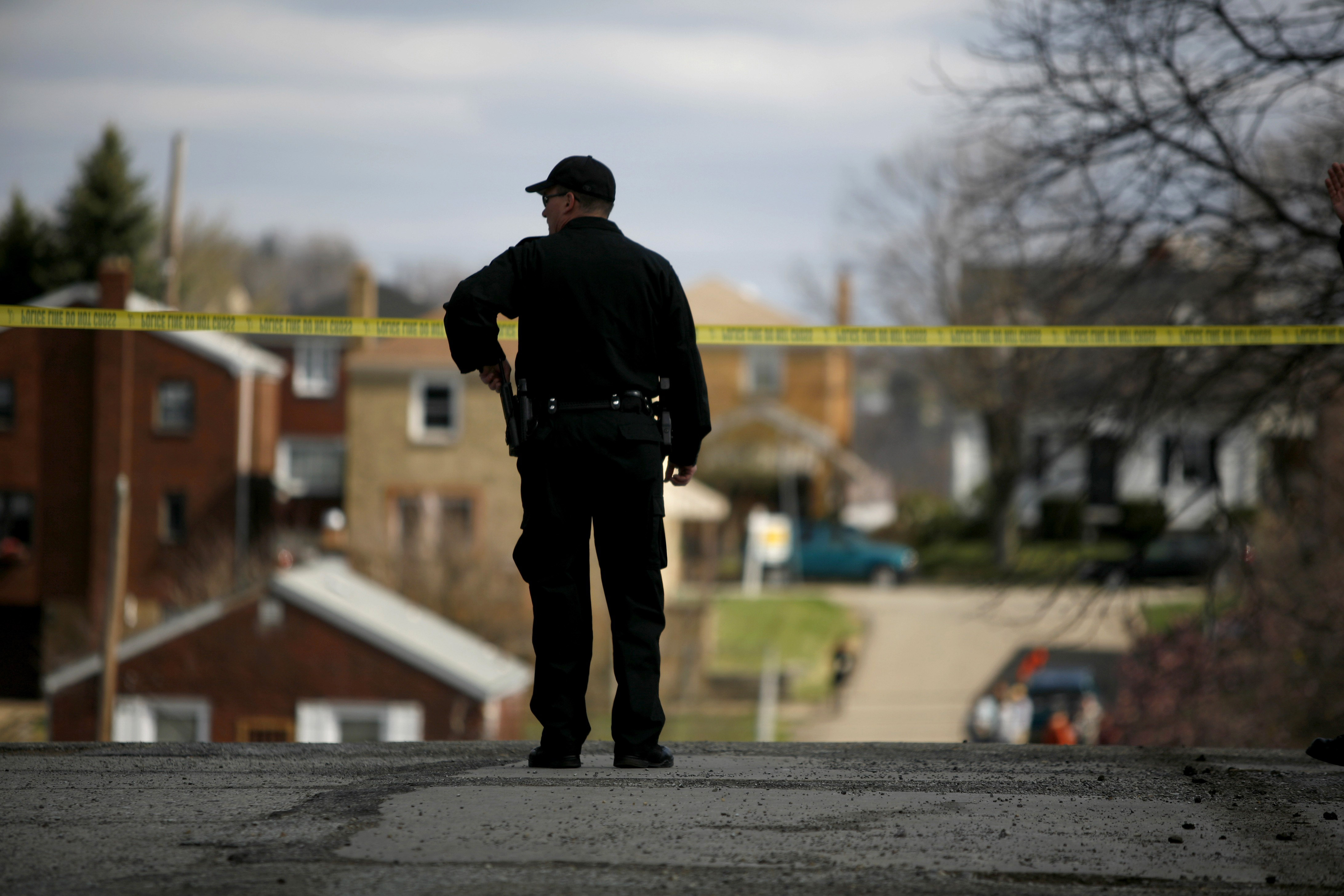 A police officer watches a crime scene on April 4, 2009, in Pittsburgh, Pennsylvania.