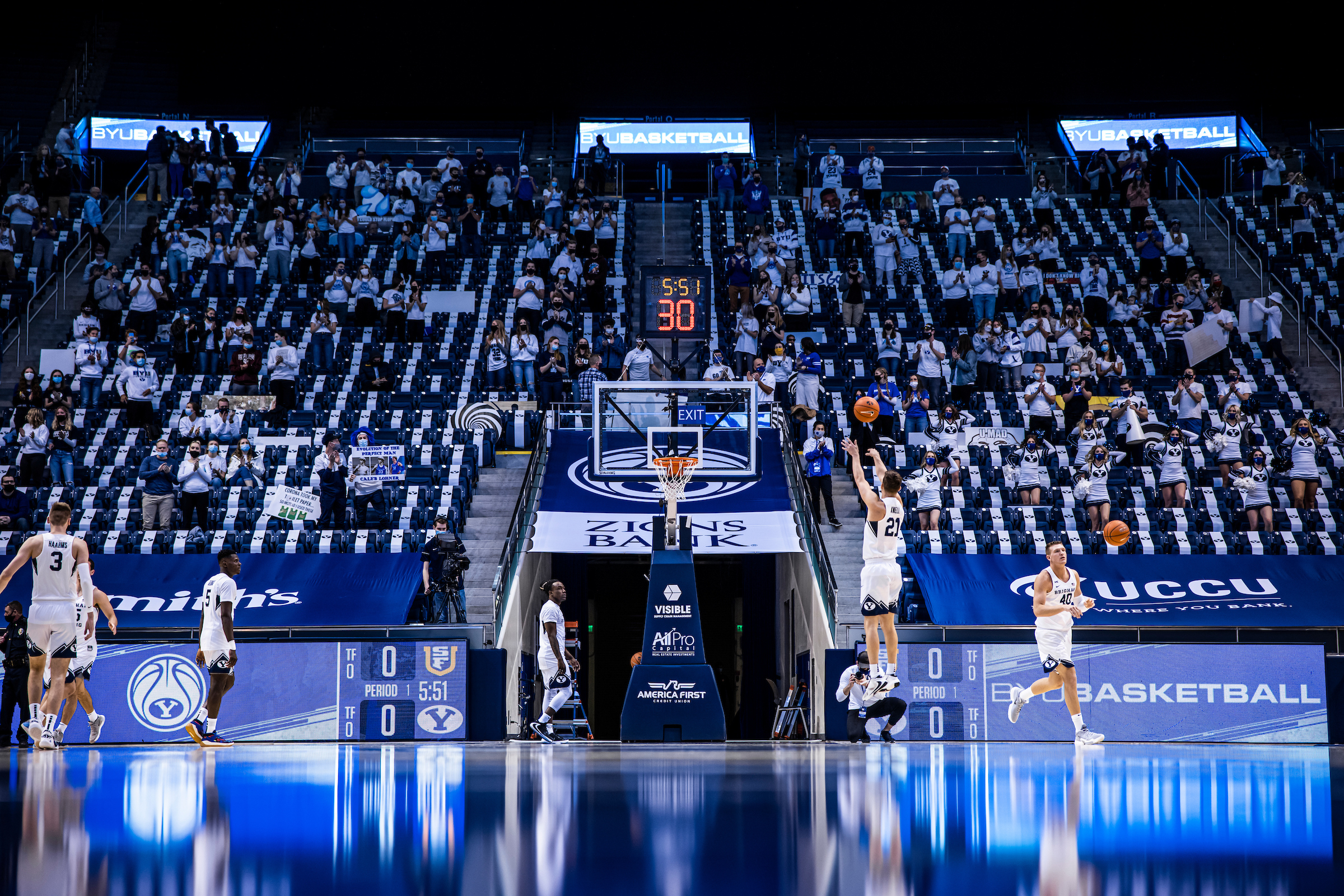 BYU players warm up prior to a game against San Francisco in the Marriott Center in Provo on Feb. 25, 2021.