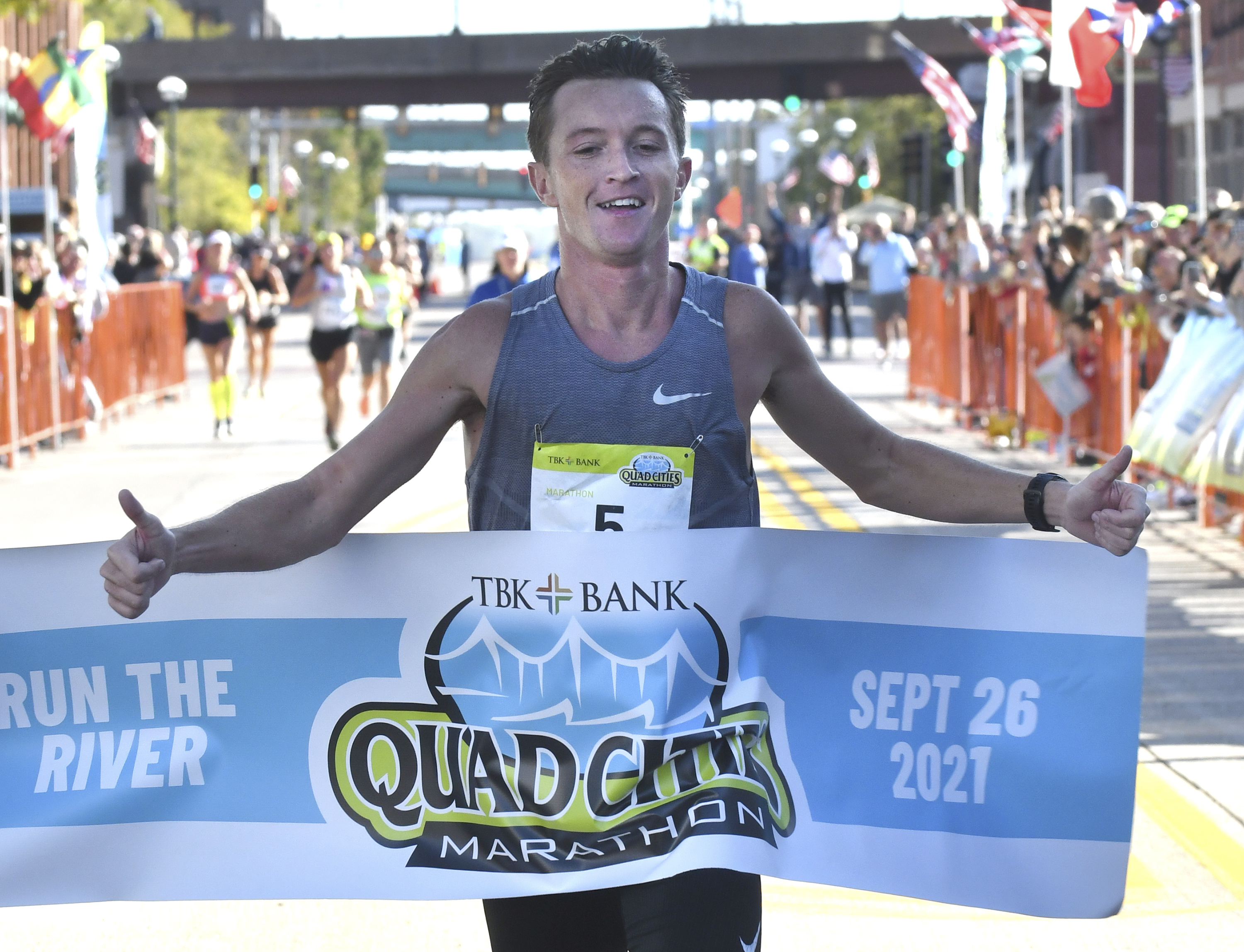 Tyler Pence of Springfield finishes first in the TBK Bank Quad Cities Marathon on Sept. 26, 2021, in Moline, Ill.