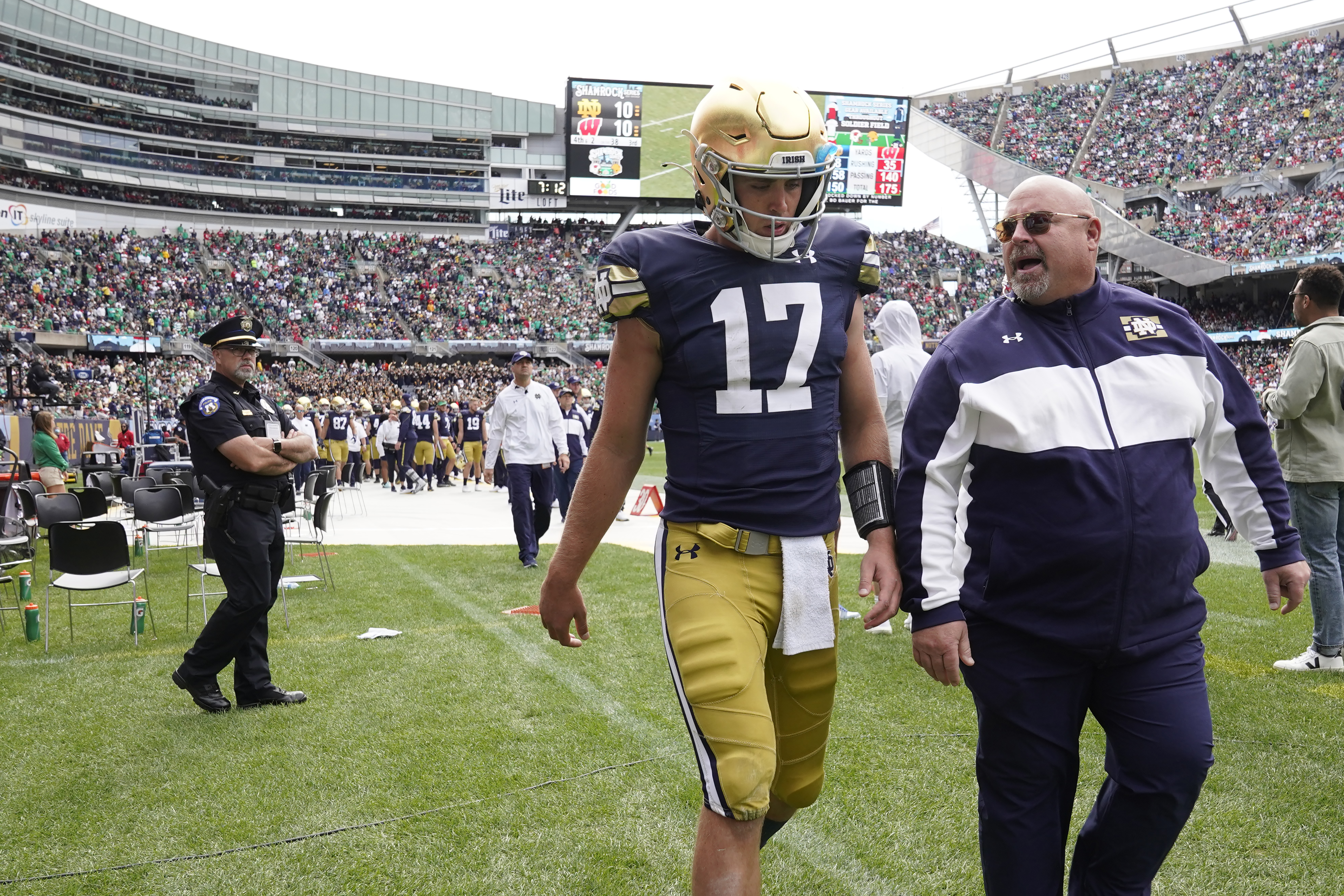 Notre Dame quarterback Jack Coan heads to the locker room after an injury during the second half of Saturday's game against Wisconsin at Soldier Field.
