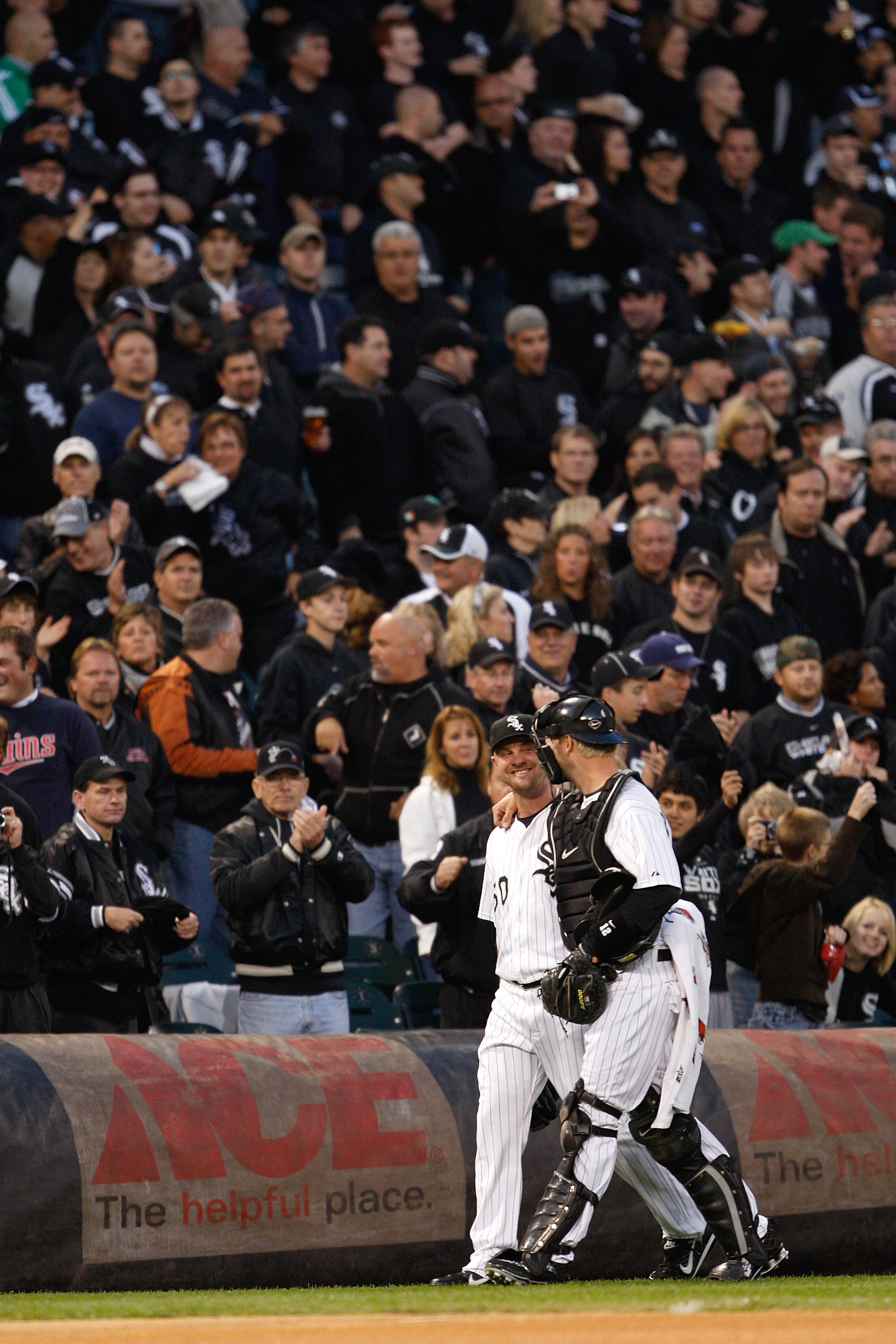 John Danks and A.J. Pierzynski of the White Sox walk past fans, who are all dressed in black, before the 2008 American League Central Division tiebreaker game against the Twins.