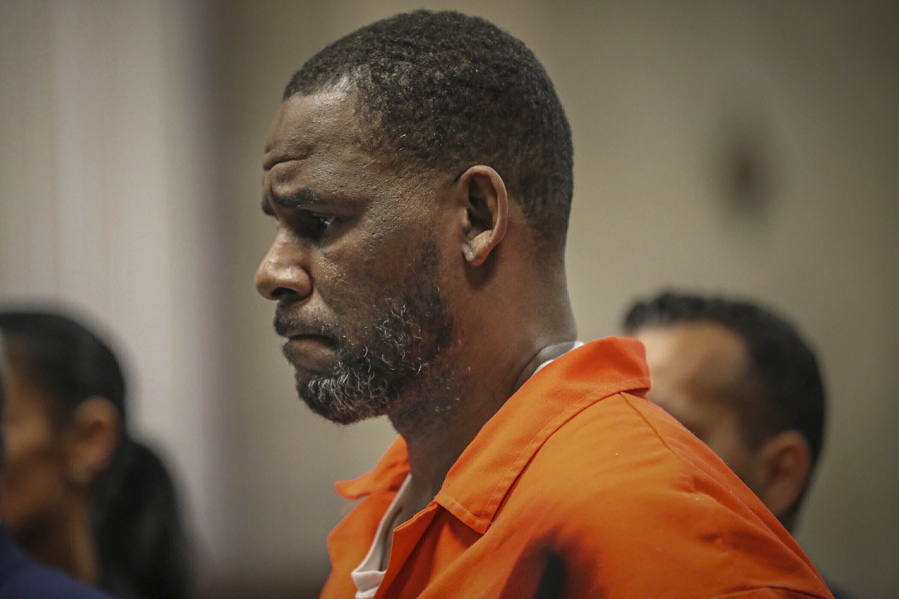 """In this Sept. 17, 2019, file photo, R. Kelly appears during a hearing at the Leighton Criminal Courthouse in Chicago. The R&B superstar known for his anthem """"I Believe I Can Fly,"""" was convicted Monday in a sex trafficking trial after decades of avoiding criminal responsibility for numerous allegations of misconduct with young women and children."""