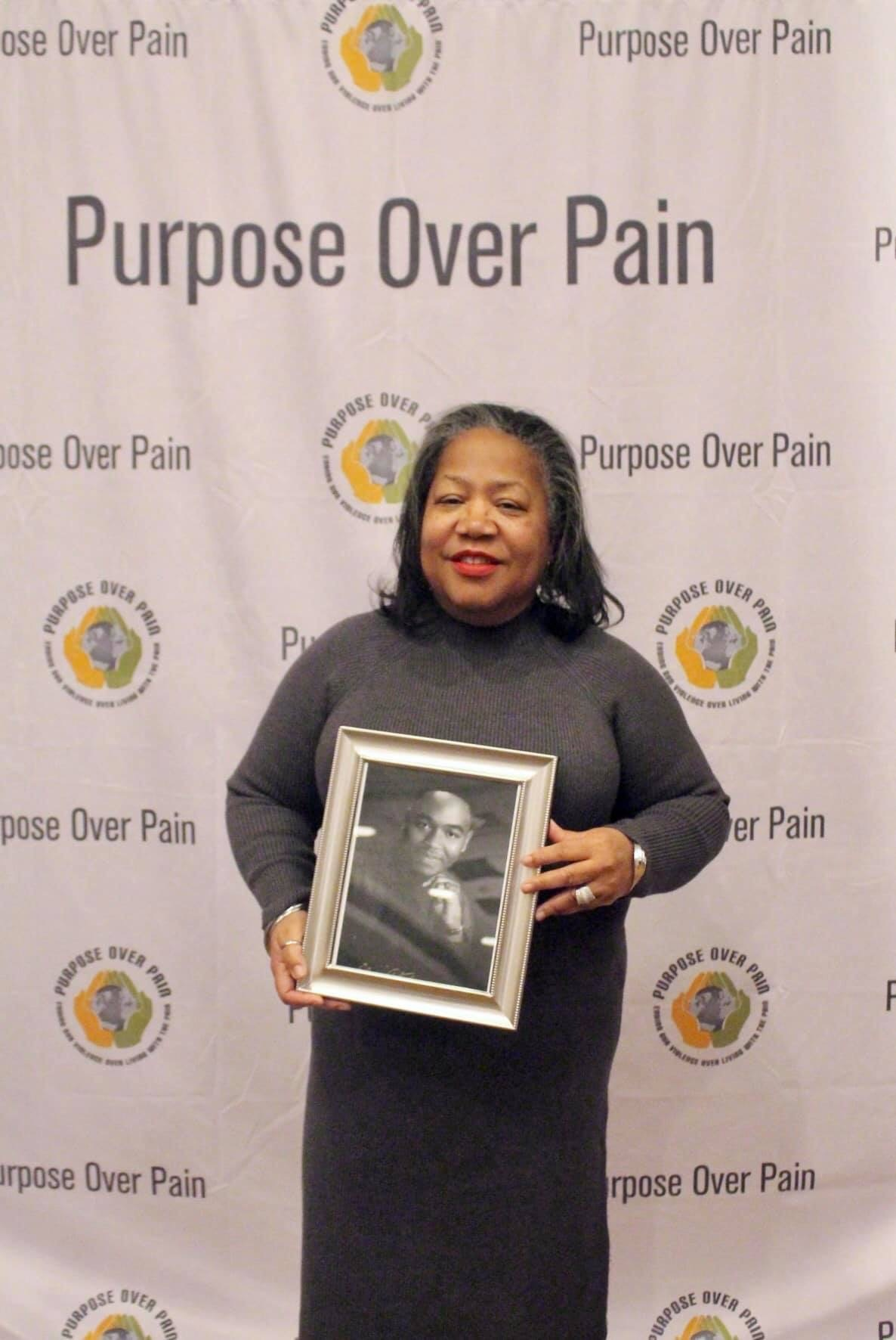 Brenda Mitchell holds a photograph of her son Kenneth Mitchell, who was killed in 2005 in south suburban Matteson.