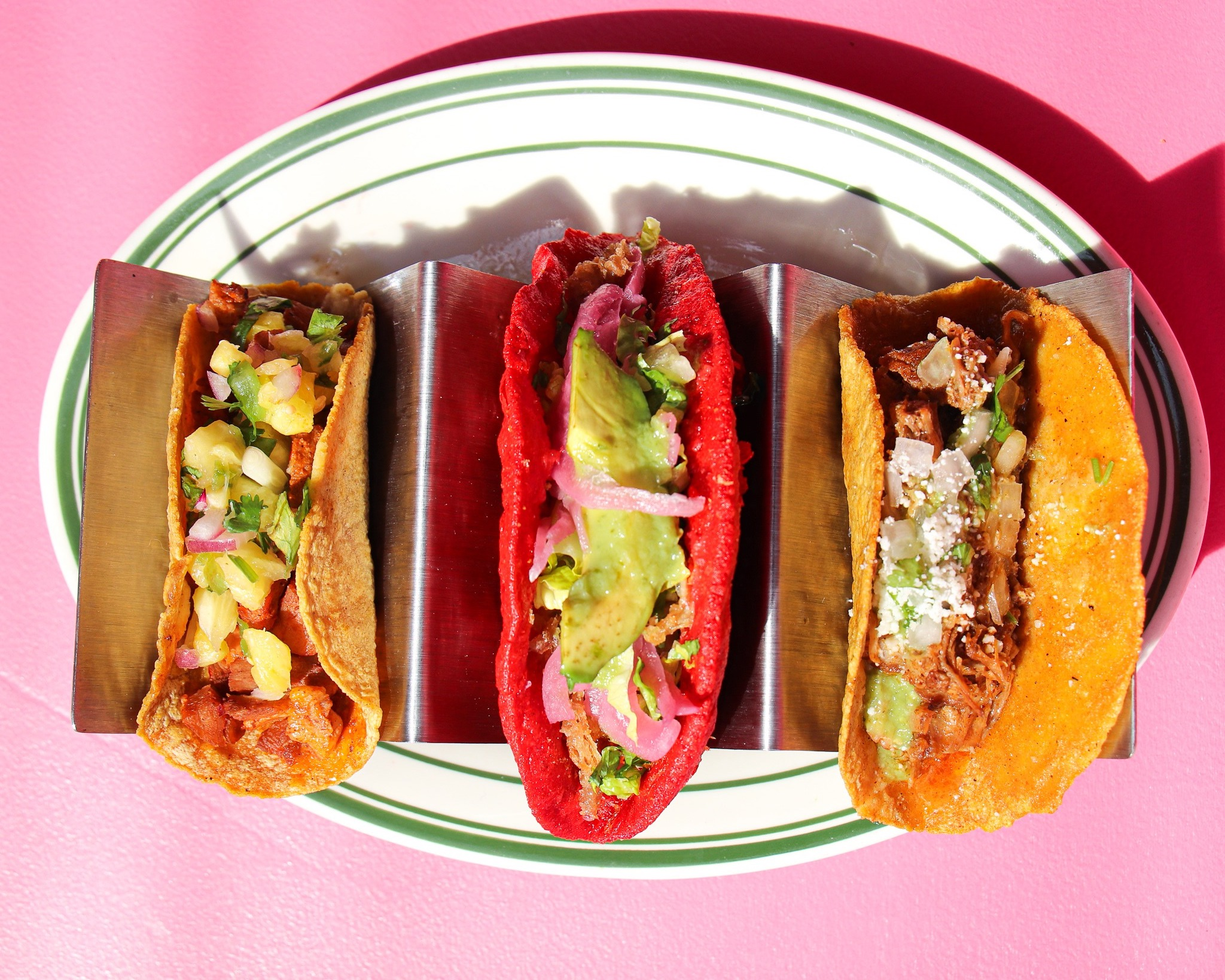 Three tacos from Pink Taco