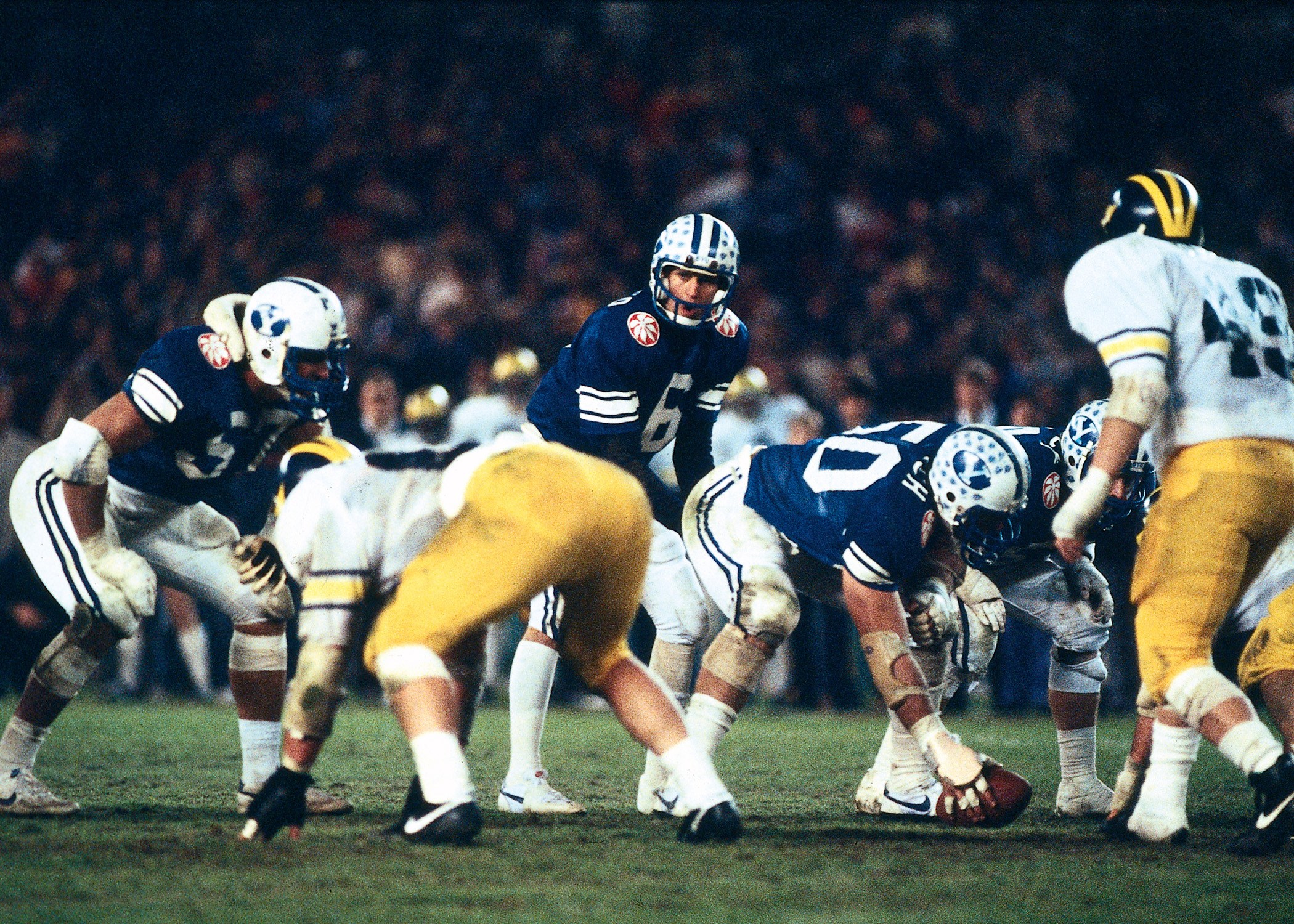 BYU quarterback Robbie Bosco prepares to take a snap during the 1984 Holiday Bowl vs. Michigan. The Cougars prevailed, 21-17.