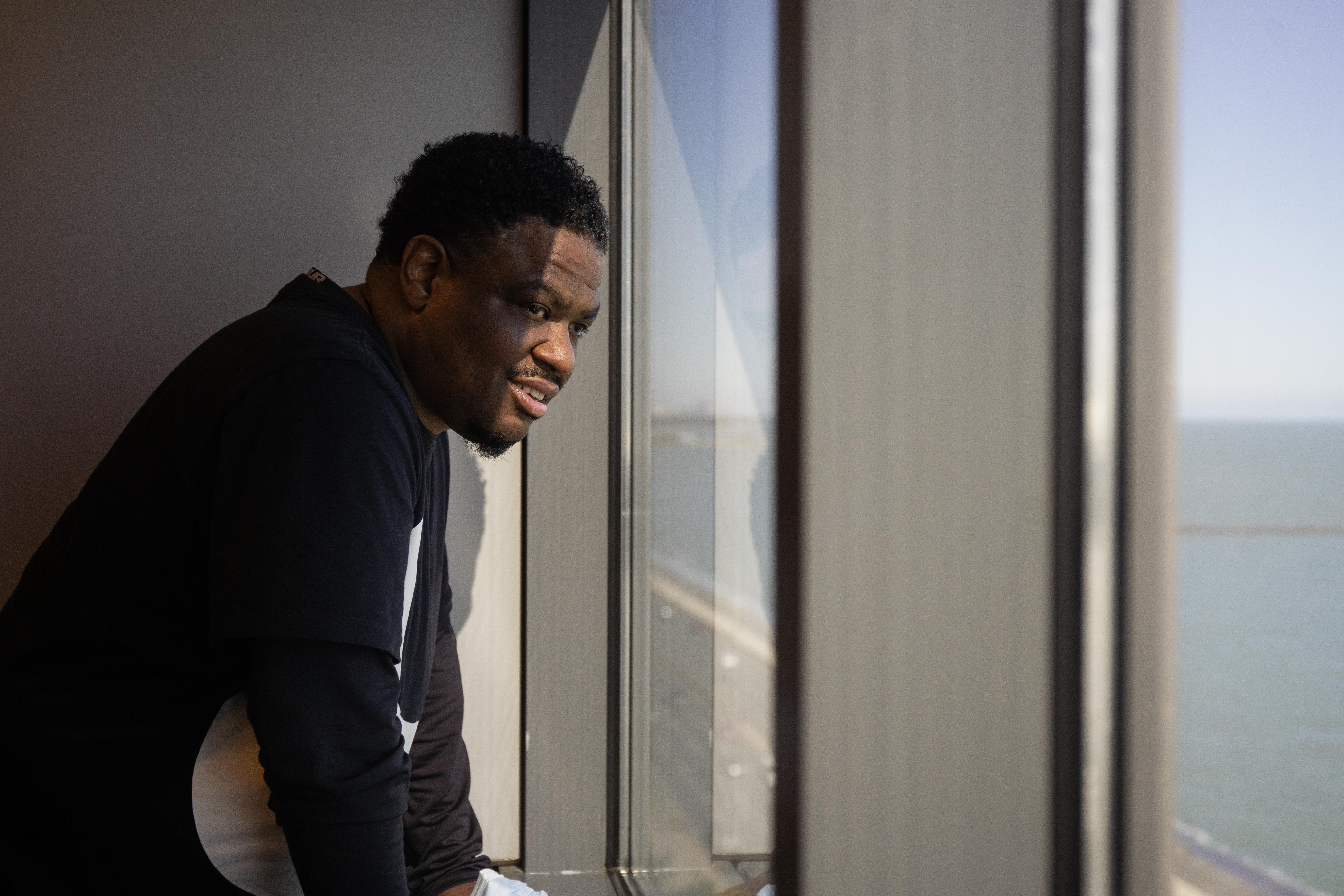 Corey Knox, 44, stares out the window at the Northwestern University Pritzker School of Law. Knox spent about 27 years in Illinois prisons, much of it in solitary confinement.