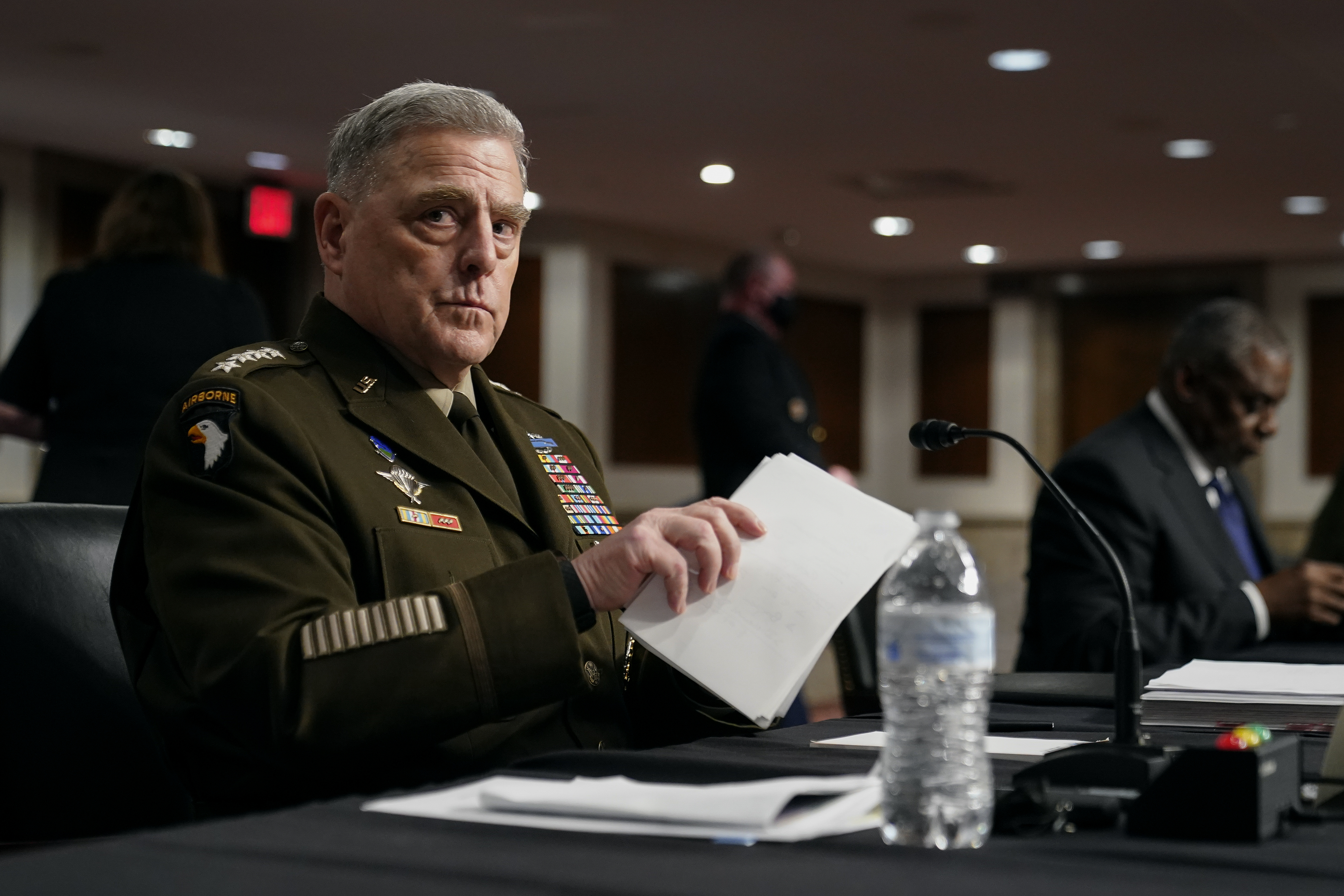 Chairman of the Joint Chiefs of Staff Gen. Mark Milley gathers his items after speaking at a Senate Armed Services Committee hearing on the conclusion of military operations in Afghanistan and plans for future counterterrorism operations, Tuesday, Sept. 28, 2021, on Capitol Hill in Washington.