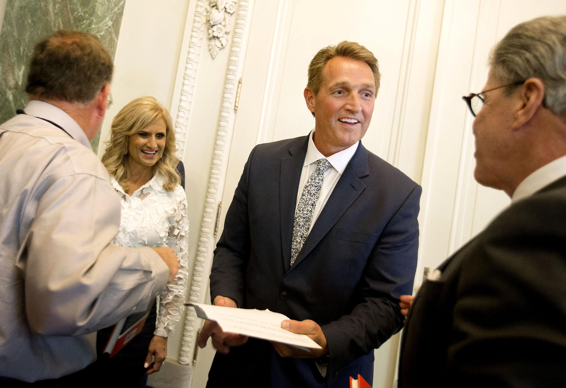 Cheryl Flake, left, and her husband, Sen. Jeff Flake, R-Ariz., speak with friends in Salt Lake City.