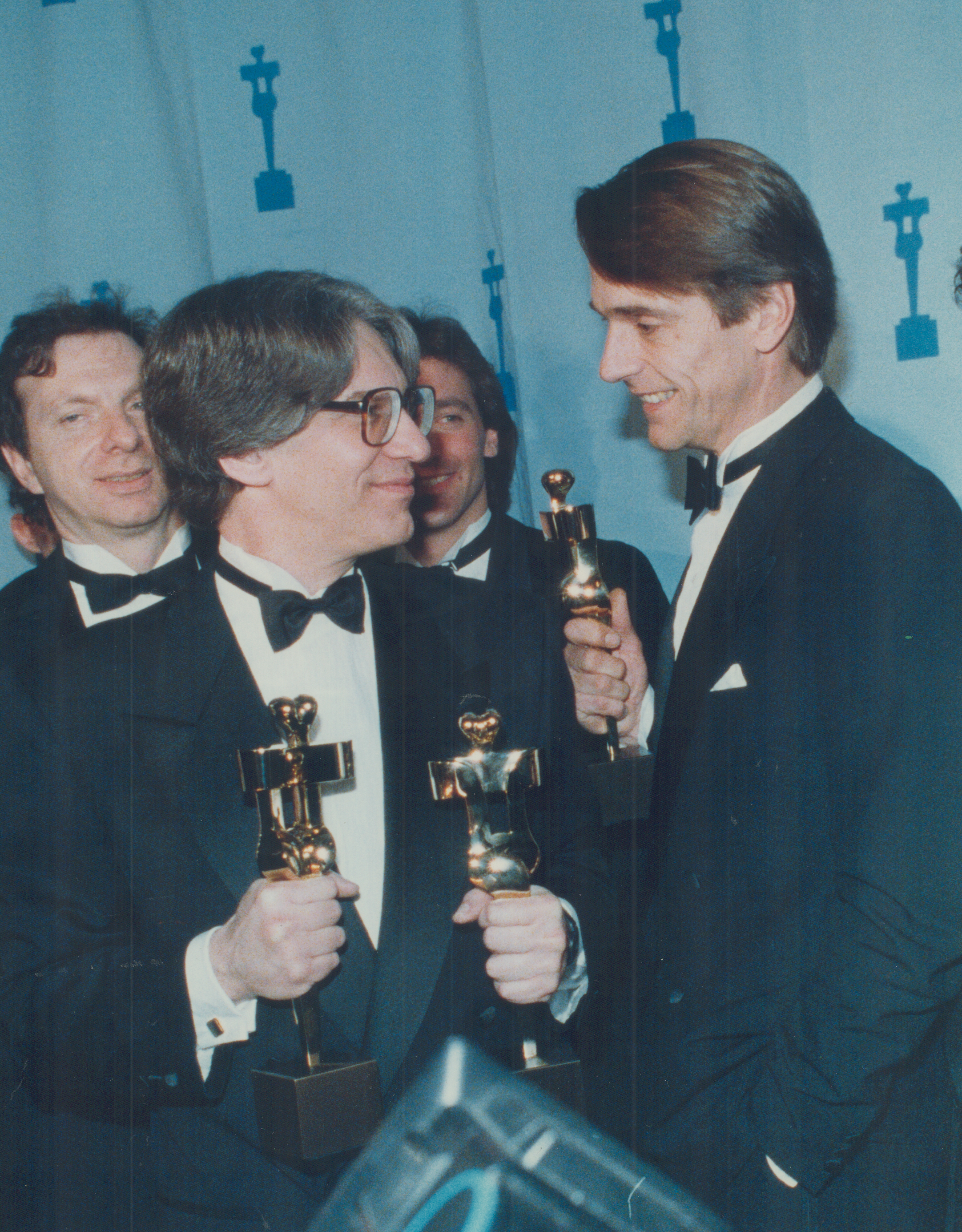 David Cronenberg, left, named best director last night, shares a moment of triumph backstage with Je
