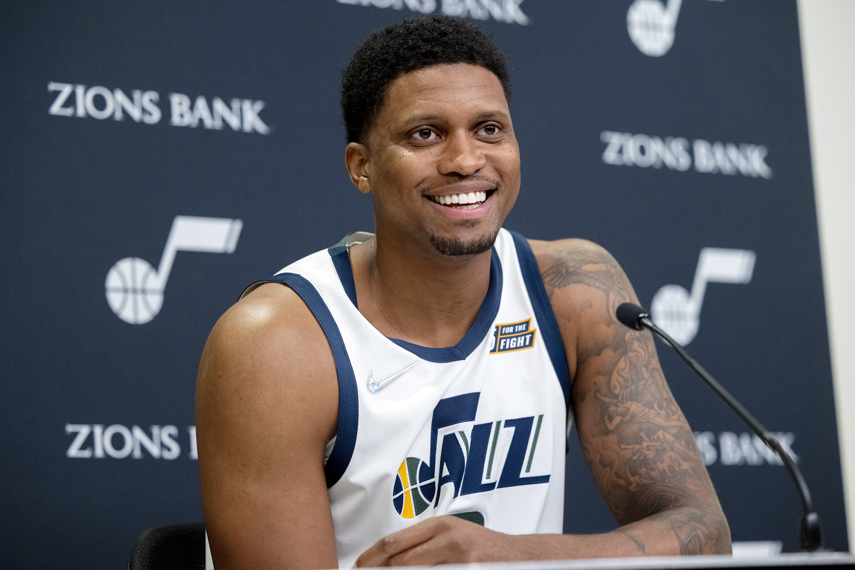 Utah Jazz forward Rudy Gay, wearing a white jersey, smiles