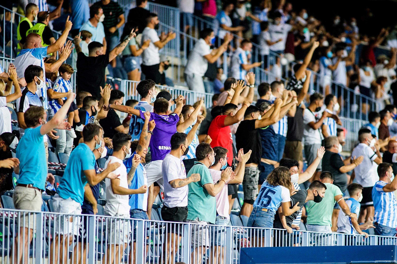 Malaga CF fans seen celebrating a goal scorred by Alberto...