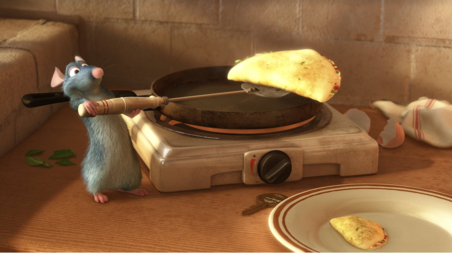 A still from the Movie Ratatouille depicting a cartoon rat holding a spatula with a piece of cheese on it.