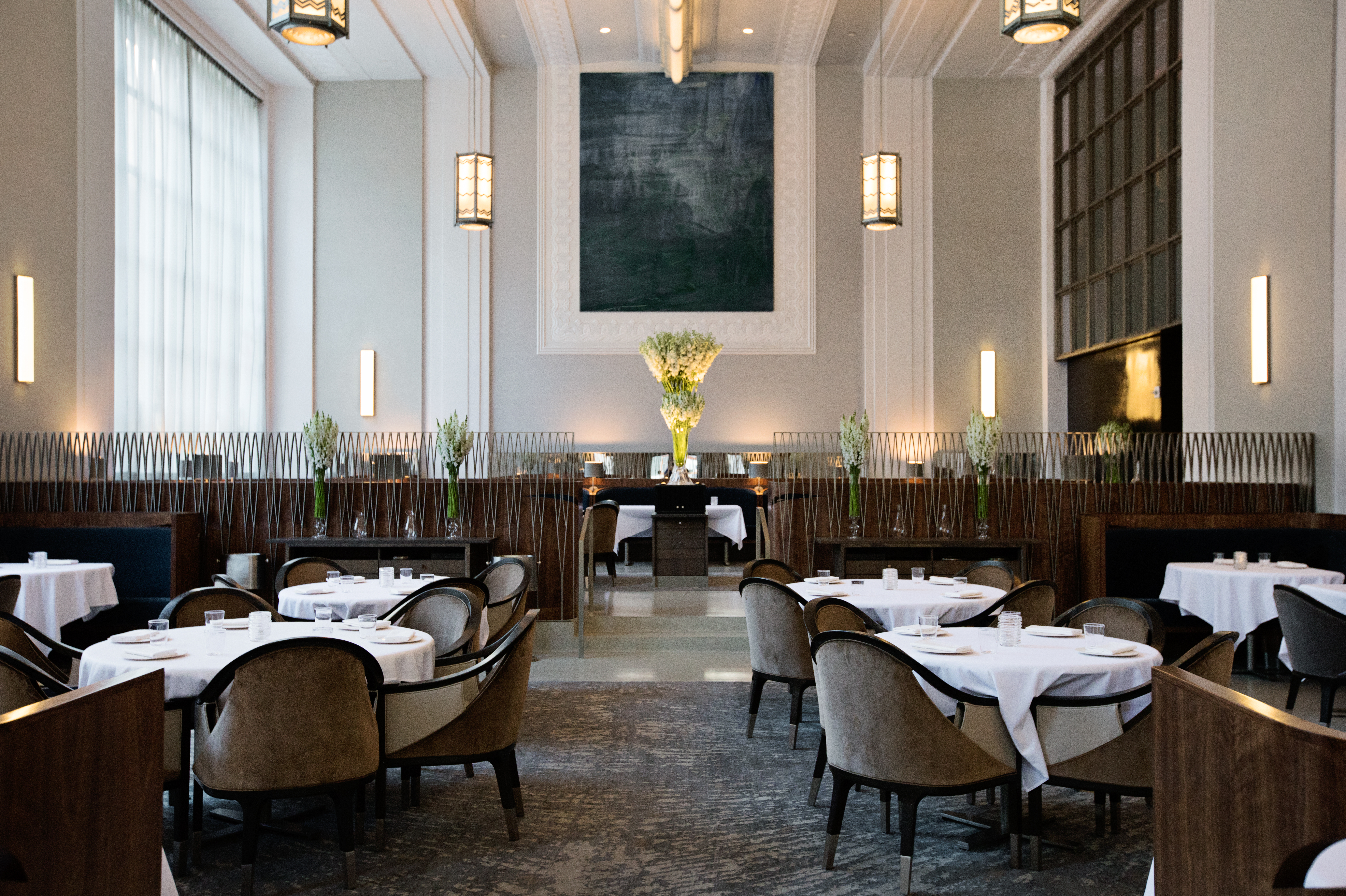 Tables stand empty before service at the cavernous Eleven Madison Park
