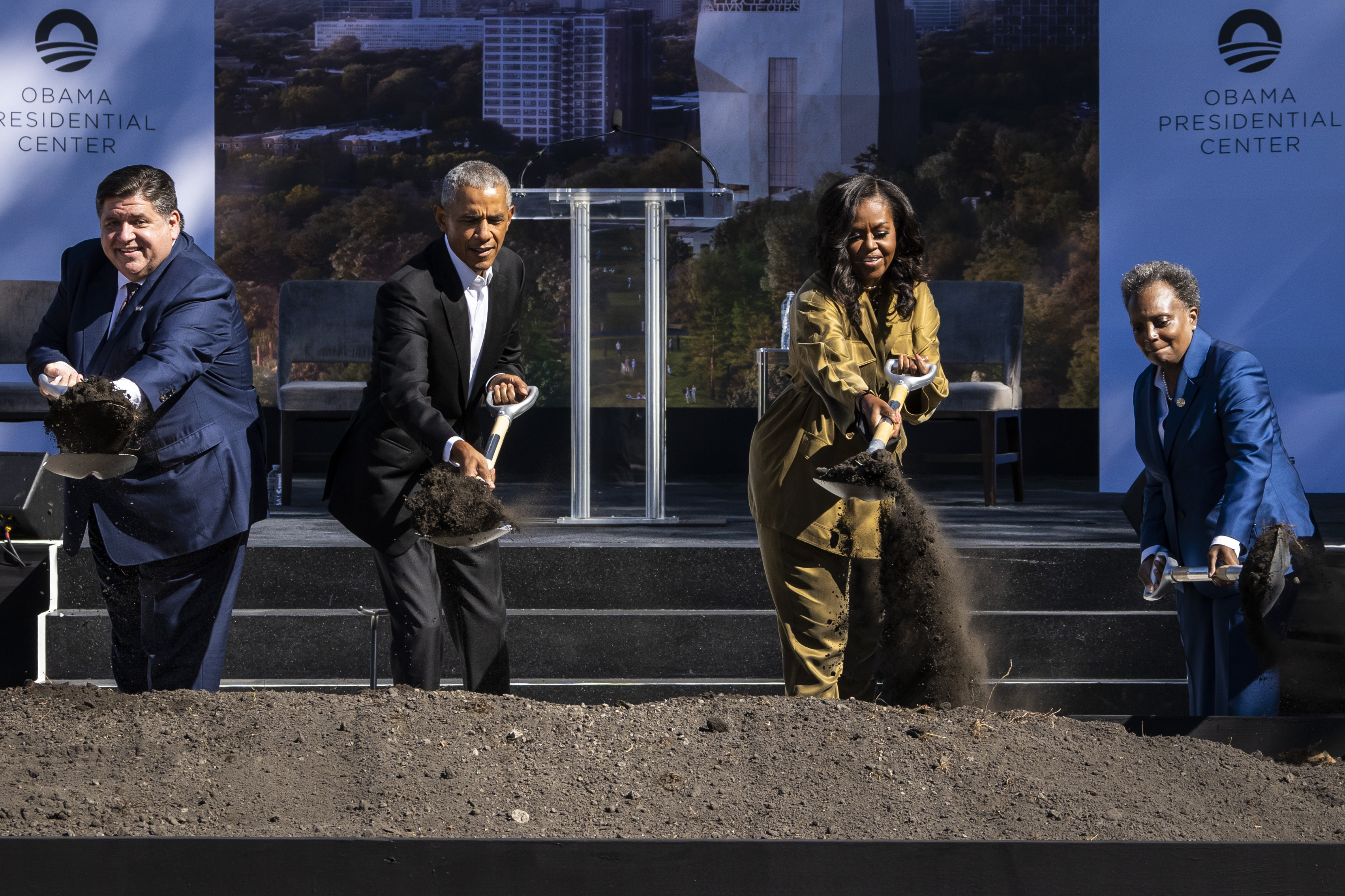 Former President Barack Obama and first lady Michelle Obama, center, break ground for the Obama Presidential Center in Jackson Park on Tuesday, with Gov. J.B. Pritzker and Mayor Lori Lightfoot.