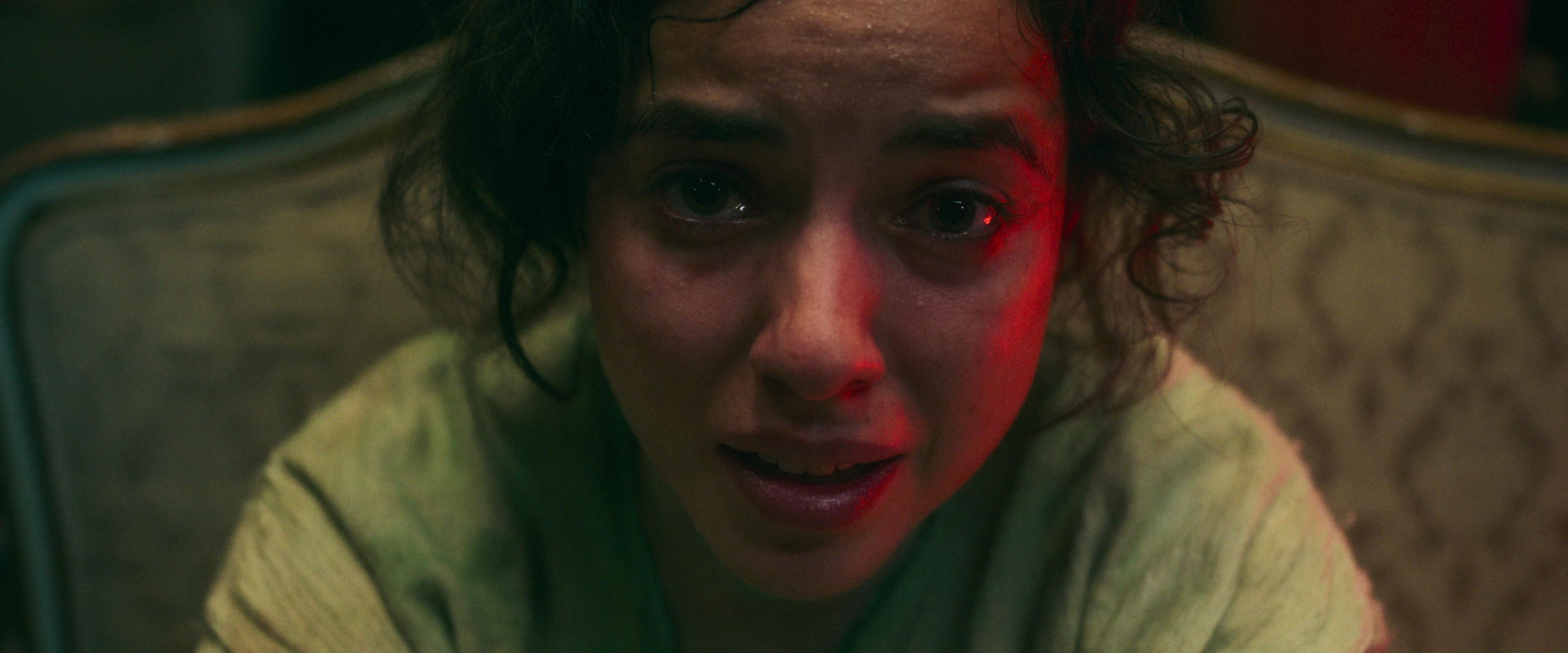 Cristina Rodlo as Ambar, in closeup, weeping and frightened