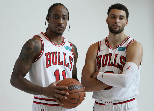 The Bulls' DeMar DeRozan and Zach LaVine pose for a photo during the team's media day.