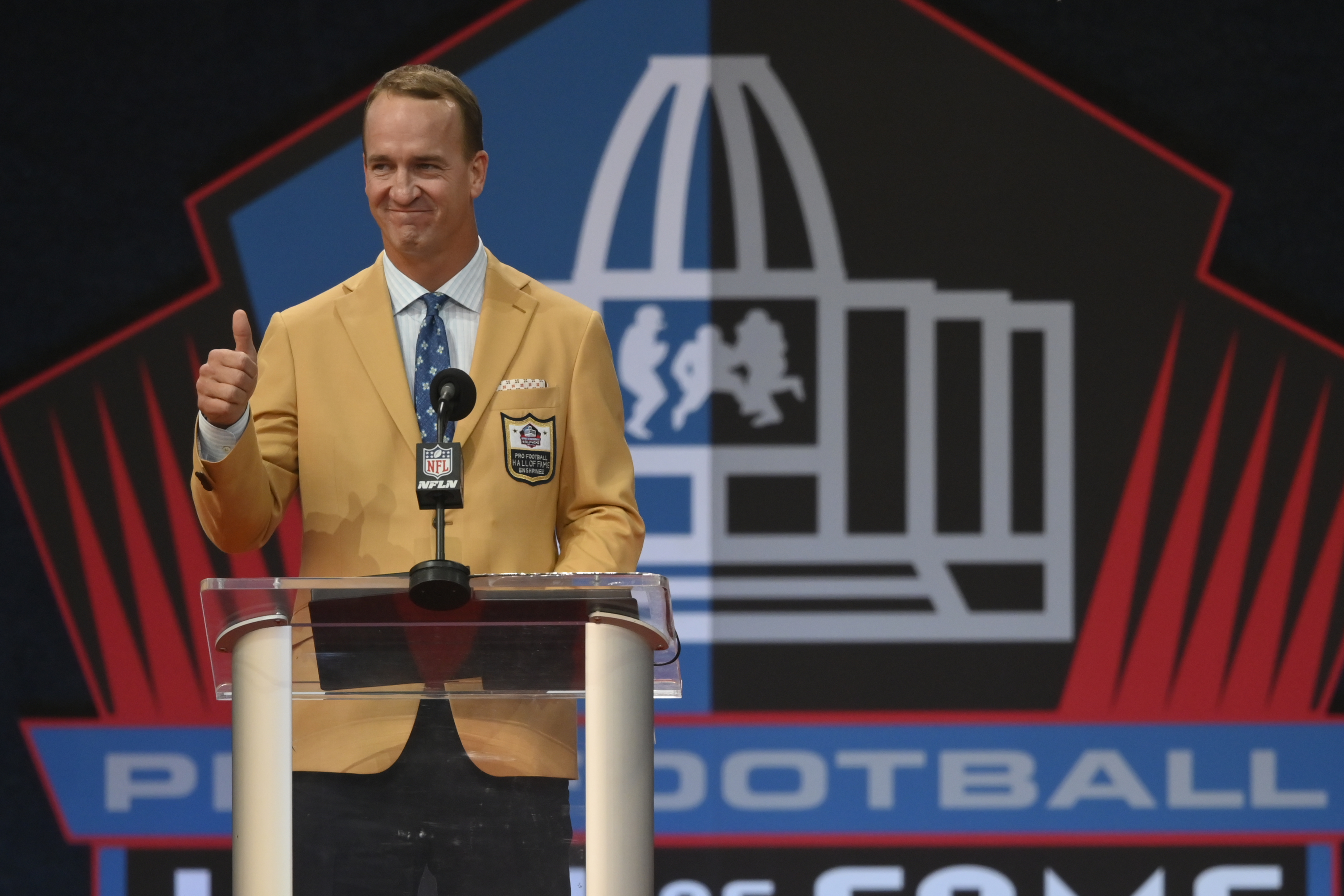 Peyton Manning, a member of the Pro Football Hall of Fame Class of 2021, speaks at the induction ceremony in Canton, Ohio.