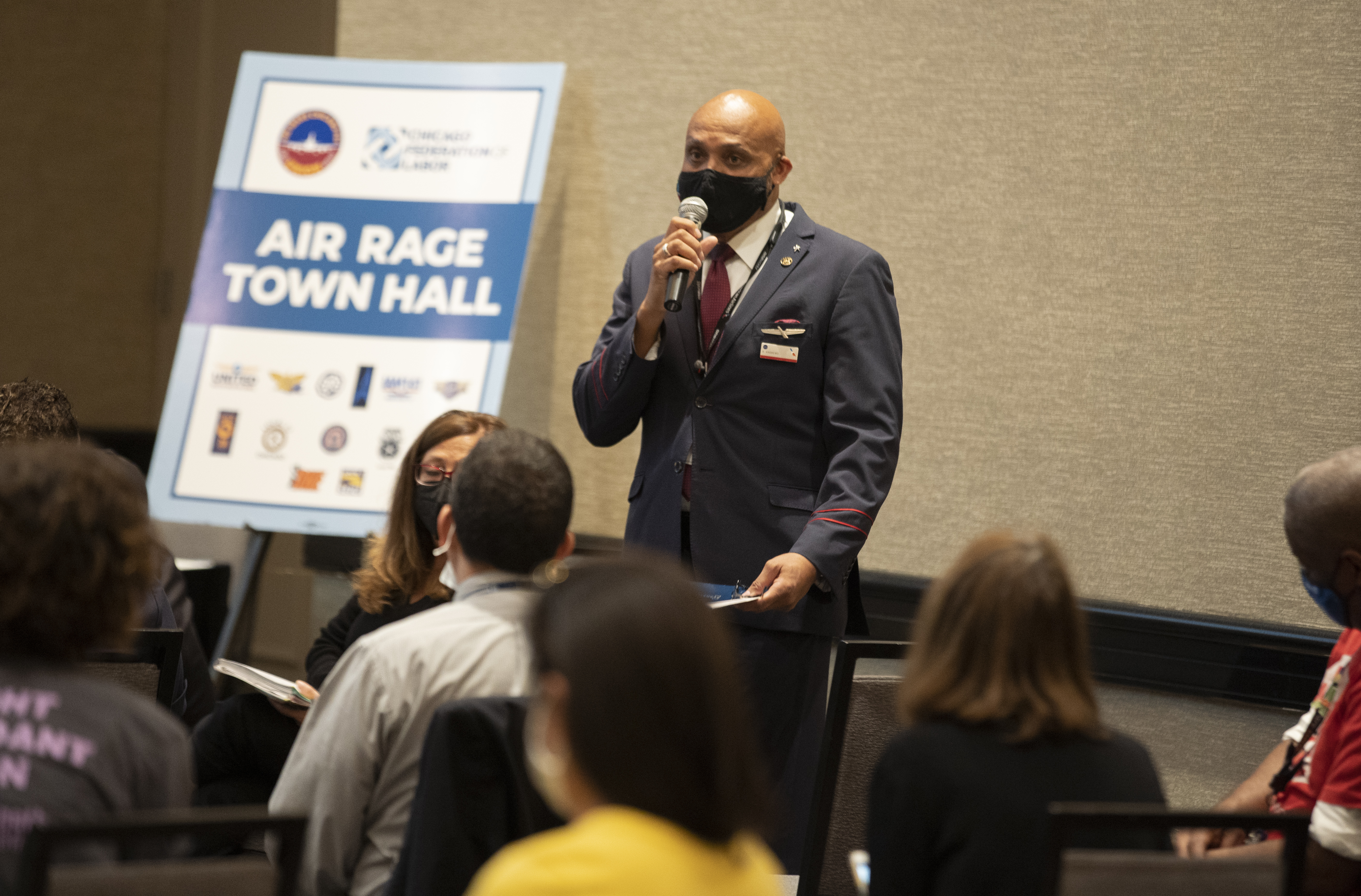 """Flight attendant Teddy Andrews urged Congress to pass legislation that heightens consequences for unruly passengers at Wednesday's """"Air Rage Town Hall"""" at O'Hare International. Andrews speaks about his experiences with unruly passengers at the Air Rage Town Hall."""