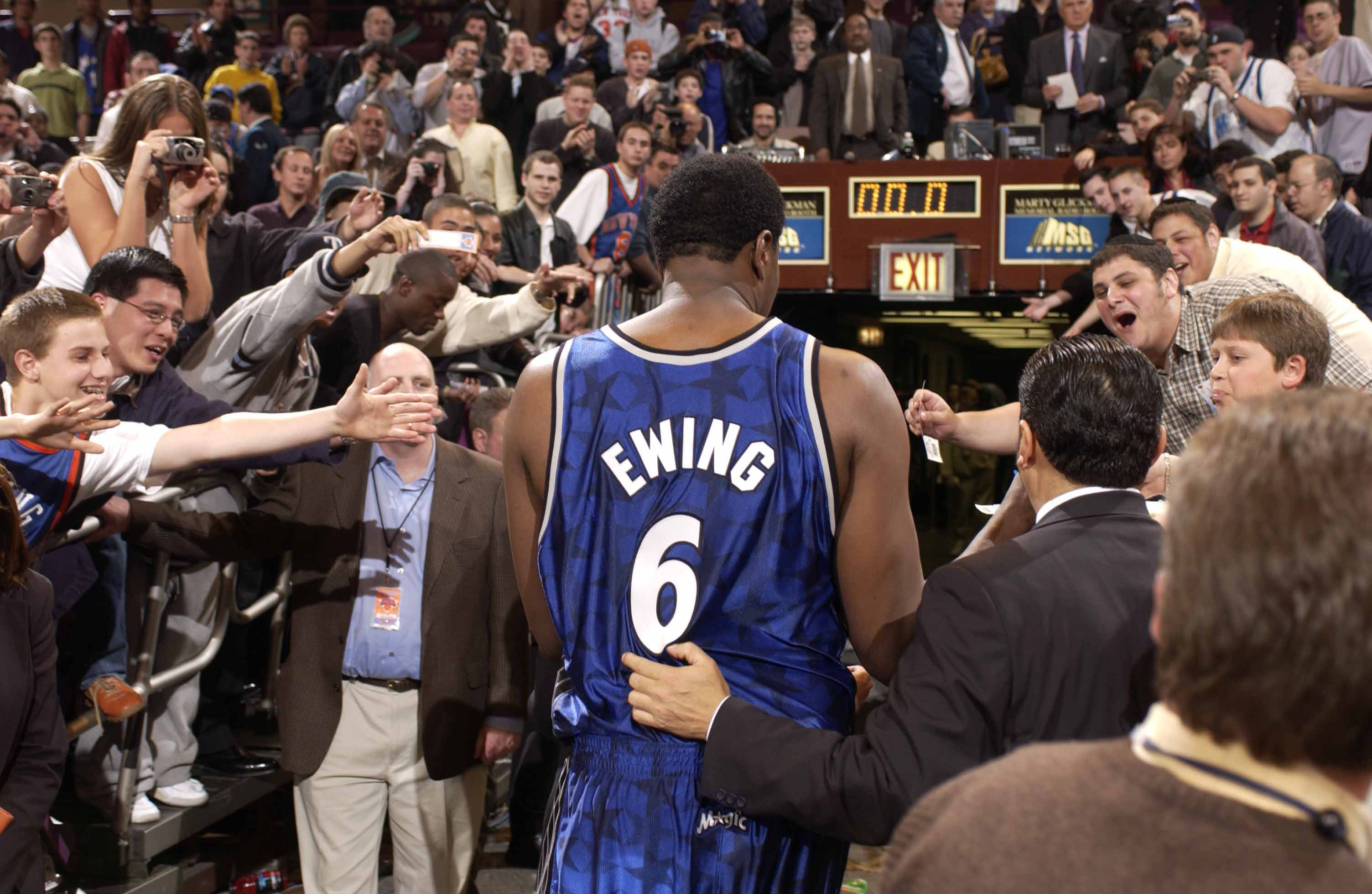 Patrick Ewing #6 of the Orlando Magic is cheered on by many fans as he leaves the floor after the game against the New York Knicks at Madison Square Garden