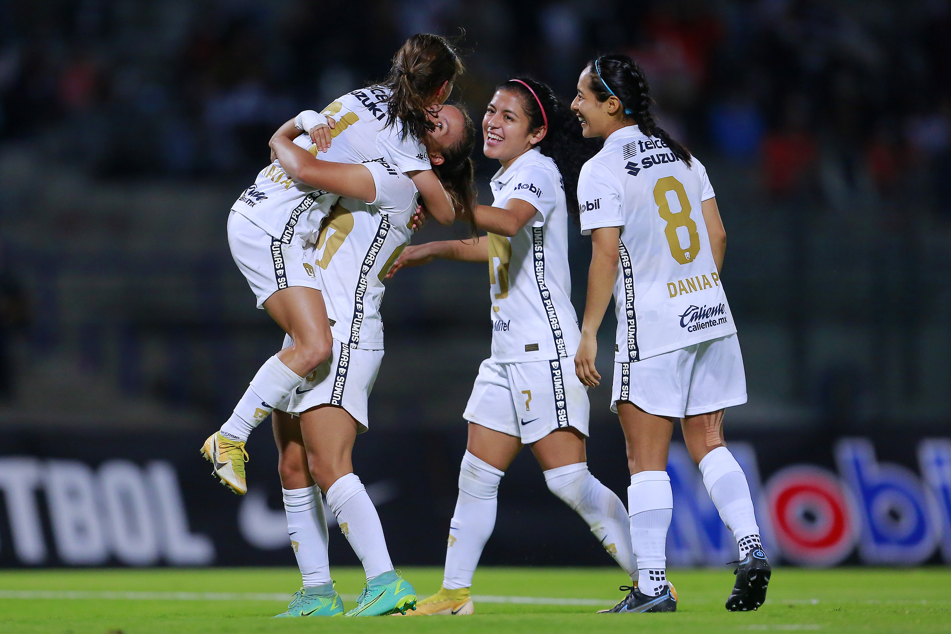 Marilyn Campa of Pumas celebrates with teammates after scoring the third goal of her team during a match between Pumas and Juarez as part of the Torneo Grita Mexico A21 Liga MX Femenil on September 27, 2021 in Mexico City, Mexico.