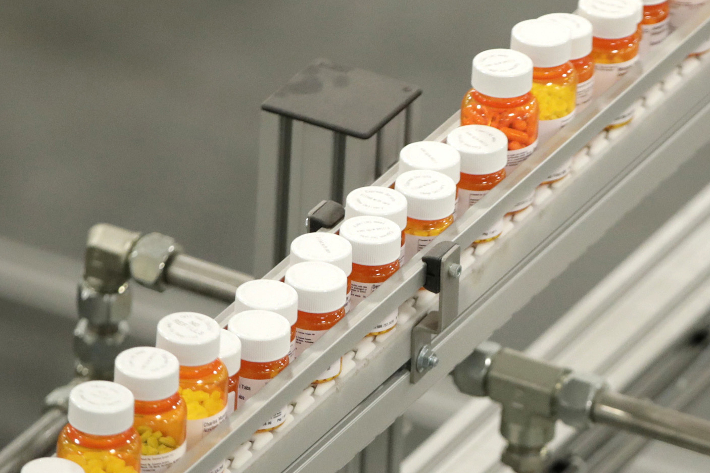 Bottles of medications ride on a belt at a mail-in pharmacy warehouse in Florence, N.J. A new study published in the New England Journal of Medicine highlights how difficult it can be for people with a long history of depression to get off their medication, even for those who feel well enough to try.