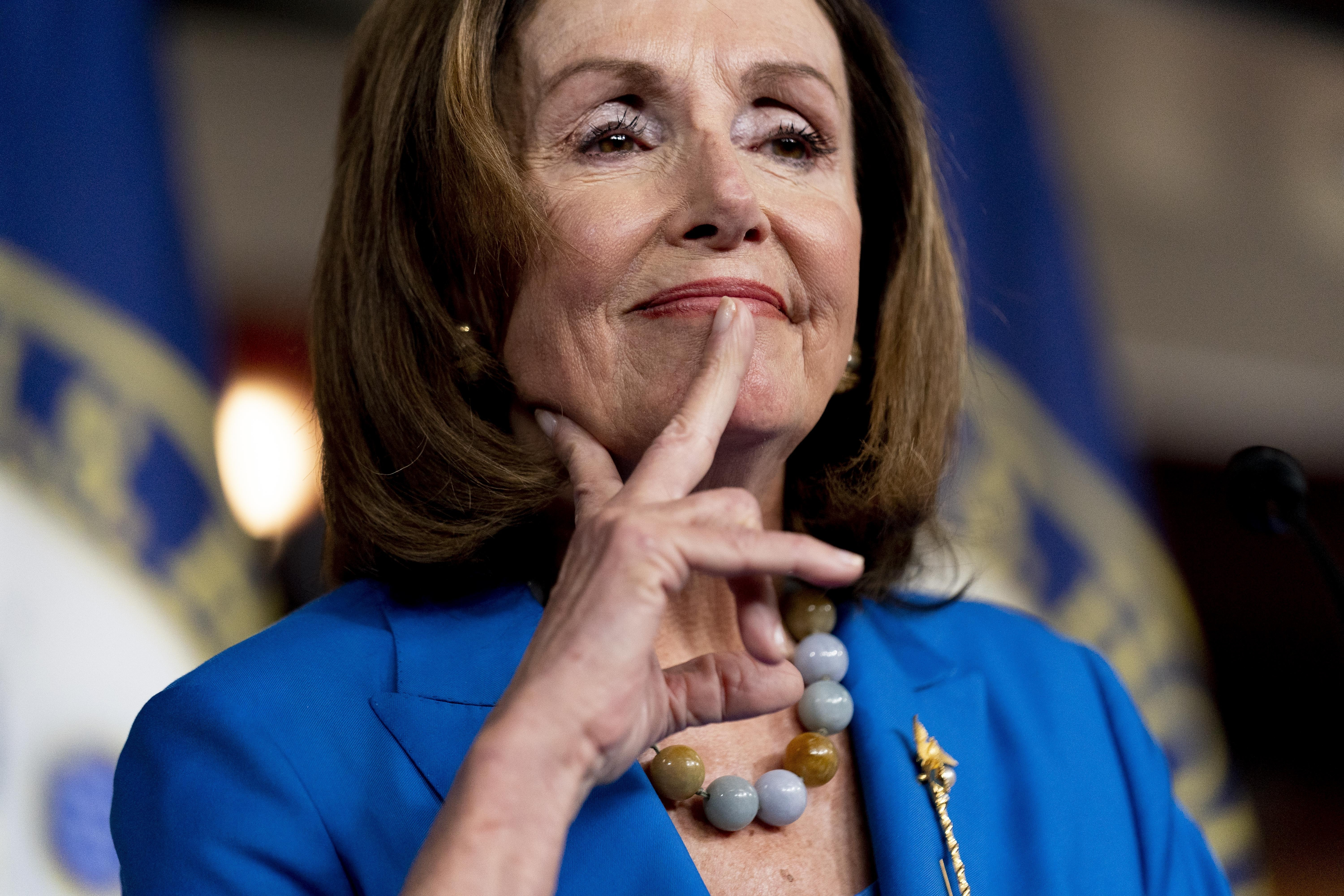 House Speaker Nancy Pelosi of Calif. reacts as she listens to a question from a reporter during her weekly press briefing on Capitol Hill, Thursday, Sept. 30, 2021, in Washington.