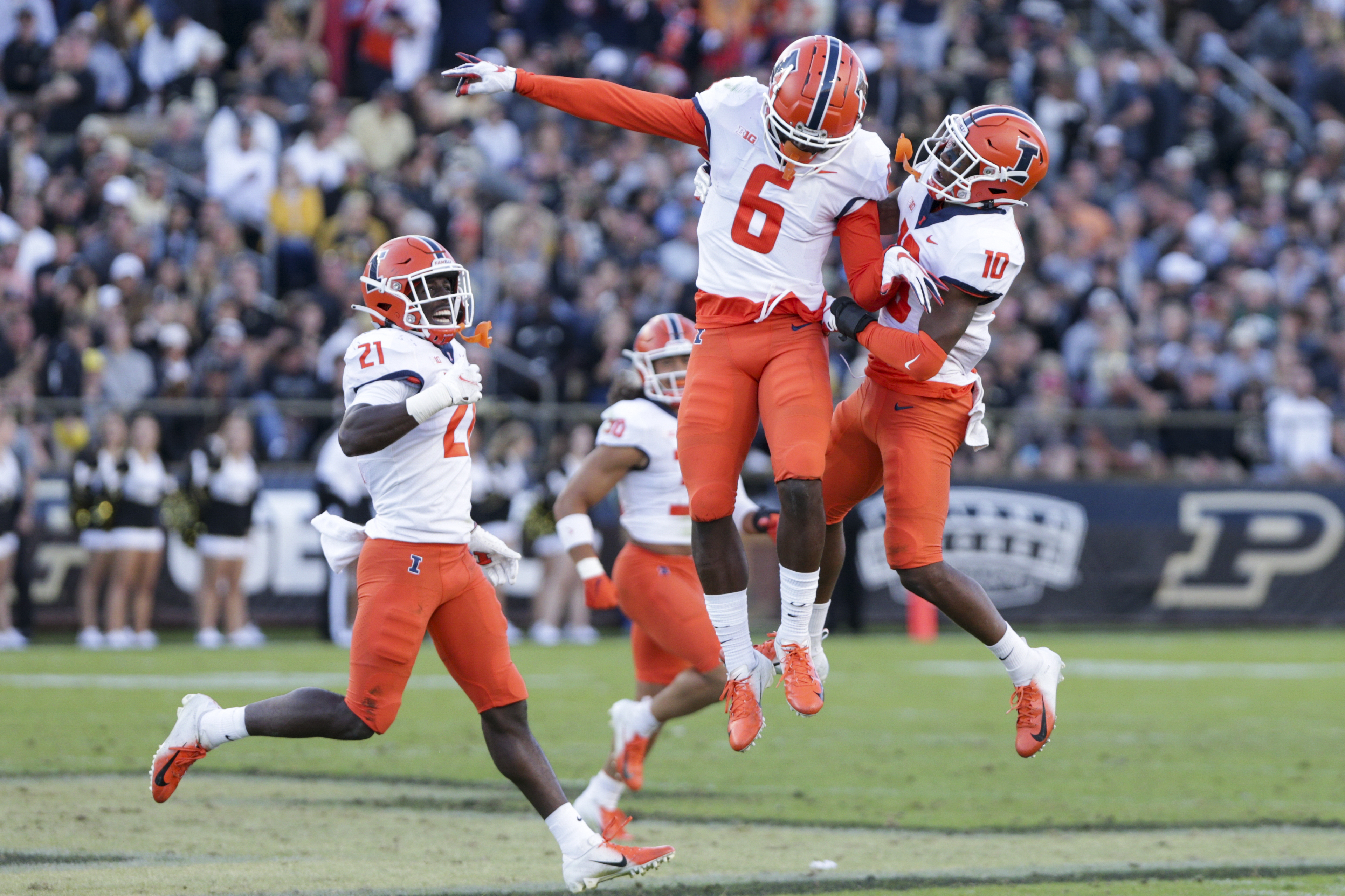 Illinois wide receivers Deuce Spann (6) and Desmond Dan Jr. (10) celebrate during the fourth quarter of last week's game against Purdue.