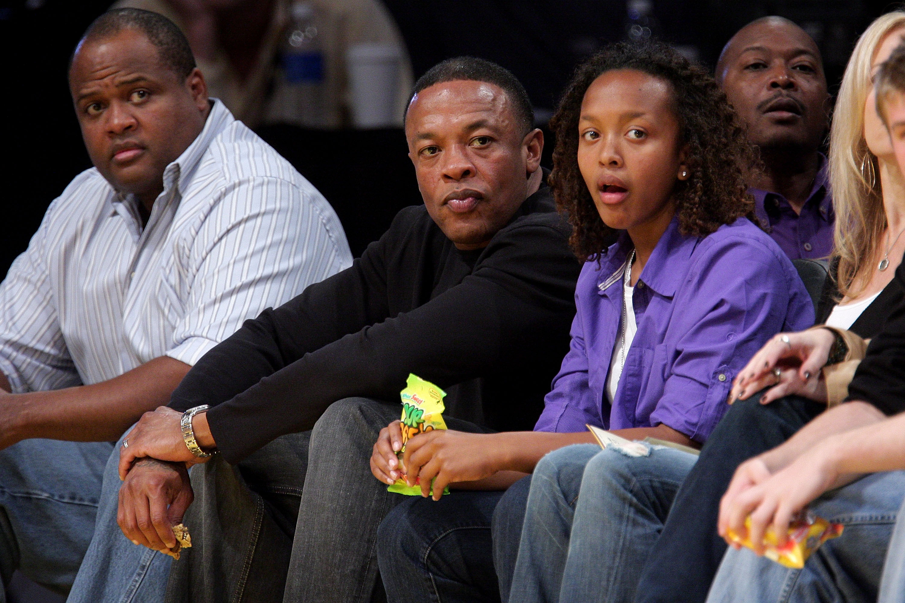 Dr. Dre (L) and his daughter Truly (R) attend the Los Angeles Lakers versus Denver Nuggets game at Staples Center on April 9, 2009 in Los Angeles, California.