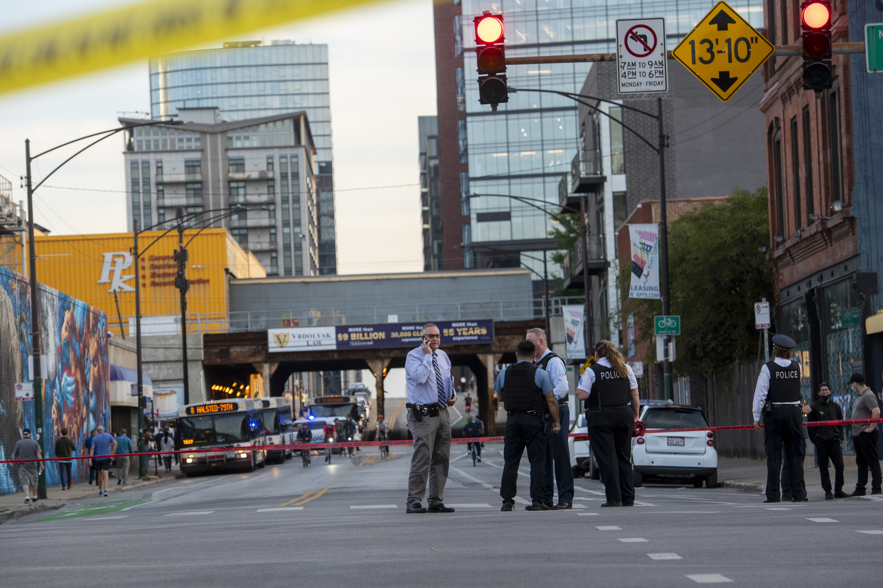Chicago police work the scene where multiple people were shot near the Grand Avenue, Halsted Street, and Milwaukee Avenue intersection, in the West Town neighborhood, Wednesday, Sept. 29, 2021.