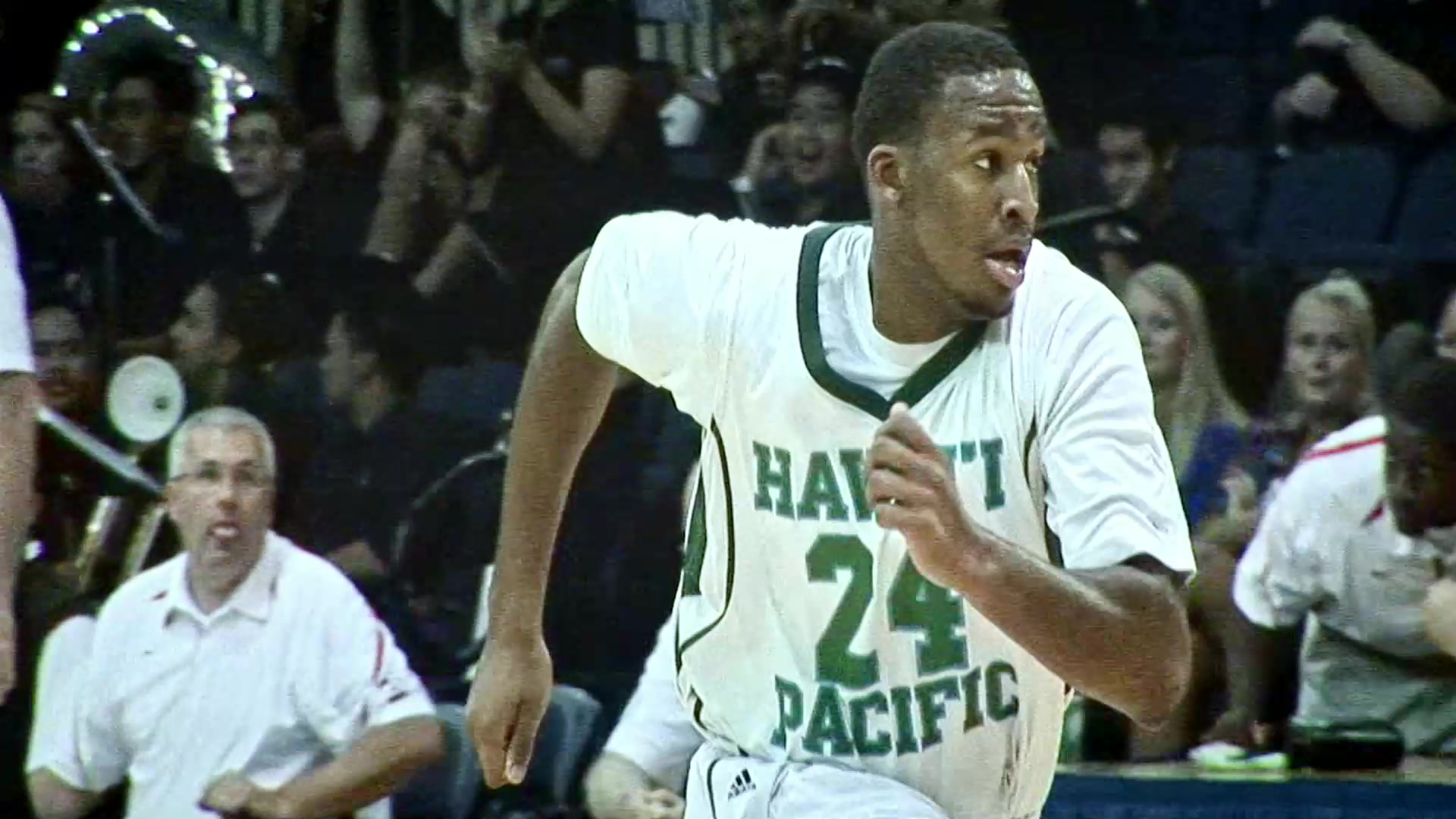 Kyle Allen running while playing in a basketball game for Hawai'i Pacific University.