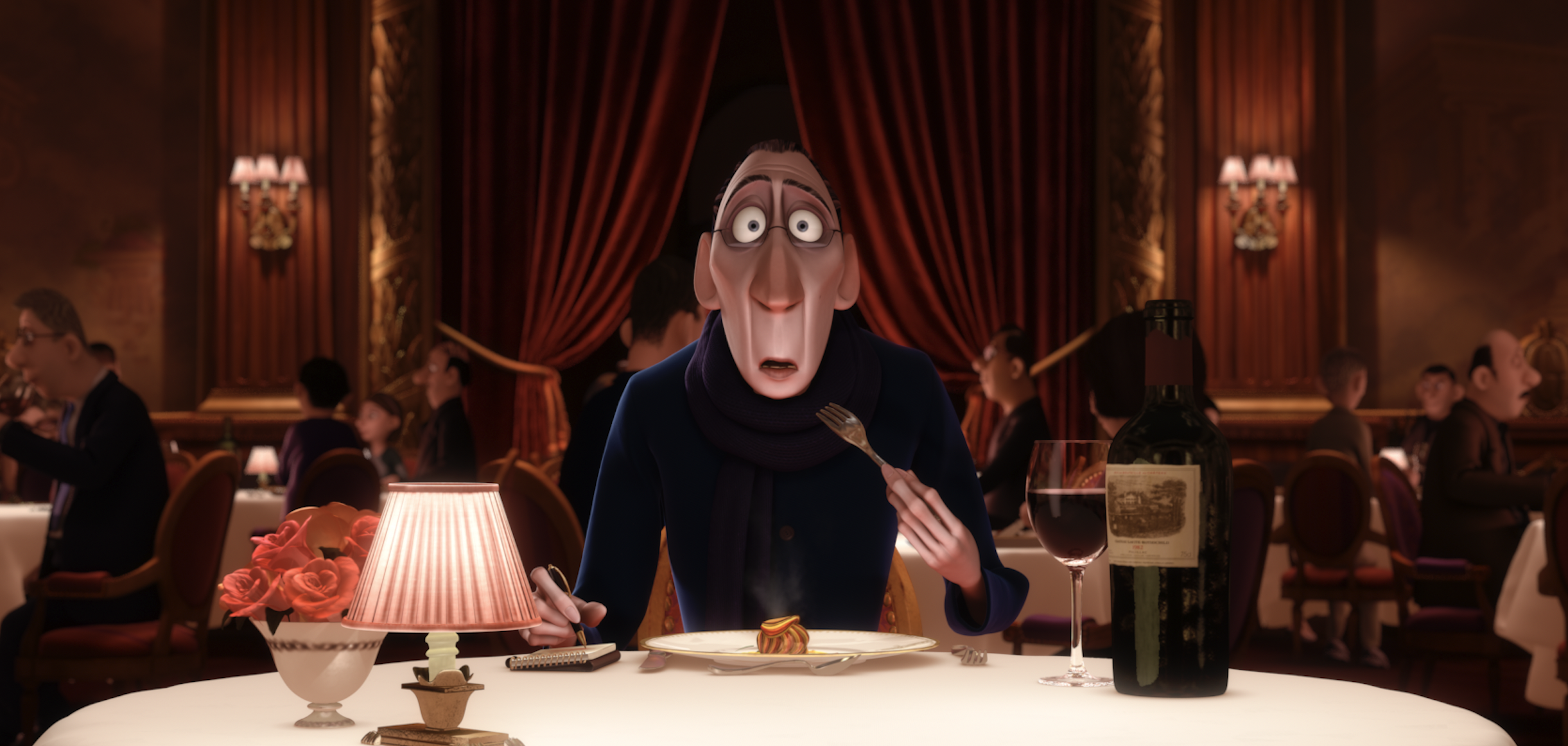 The shocked animated character of Anton Ego holds a fork mid-bite, mouth agape, while seated at a tablecloth-covered table in a formal, red-draped dining room.