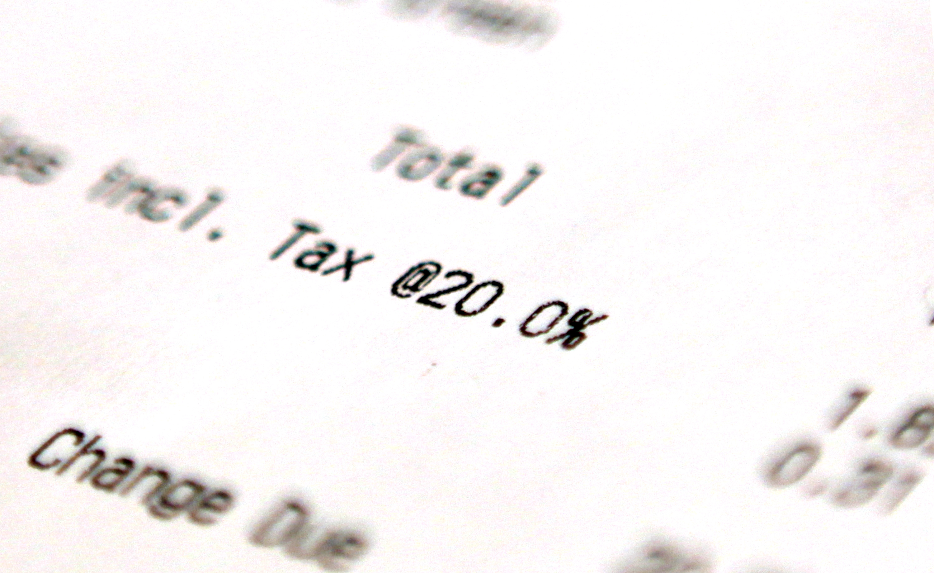 A close-up photo of a U.K. receipt, focussed on the line mentioning VAT, listed at 20 percent.