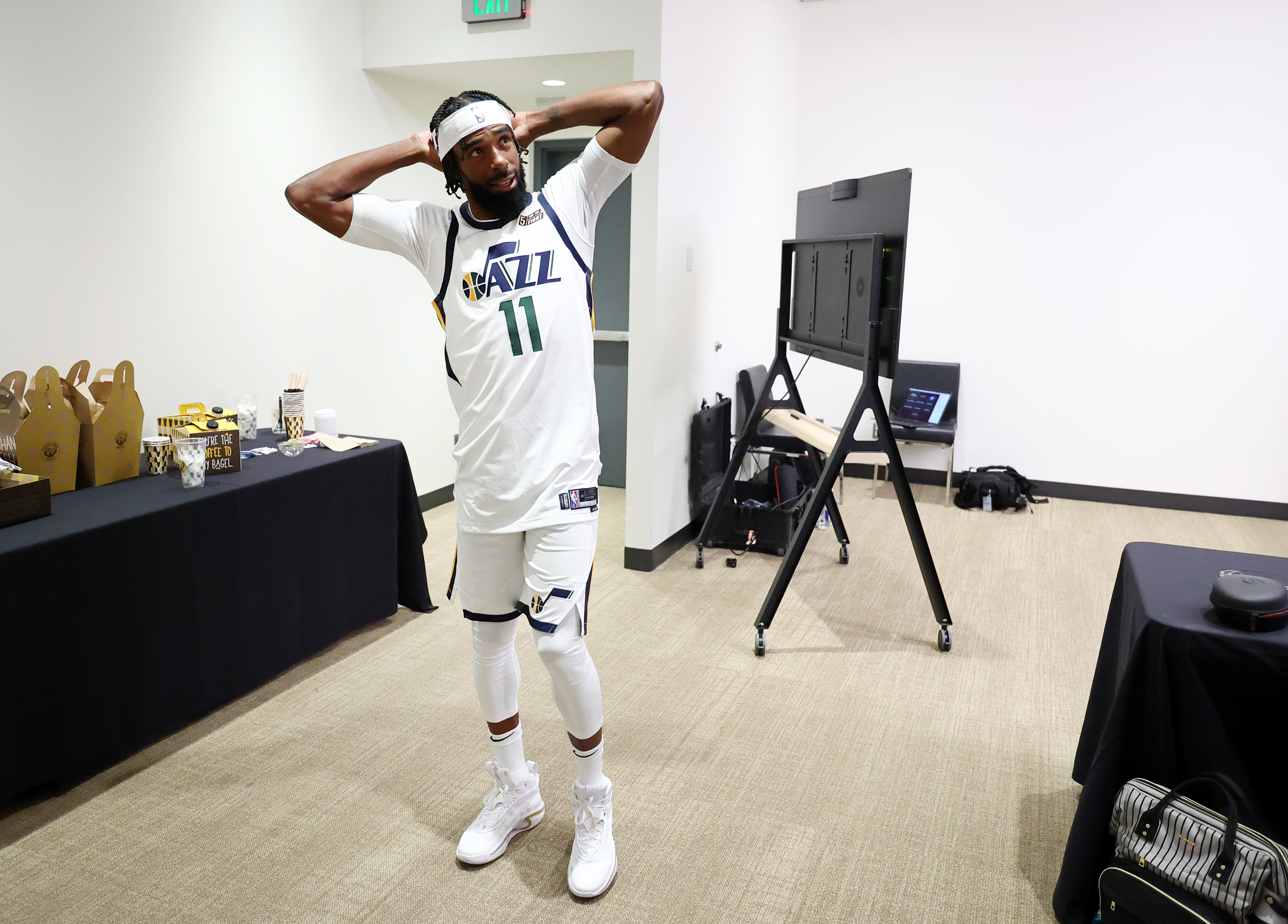 Utah Jazz guard Mike Conley has a short discussion with members of the media  at Jazz media media day in Salt Lake City.
