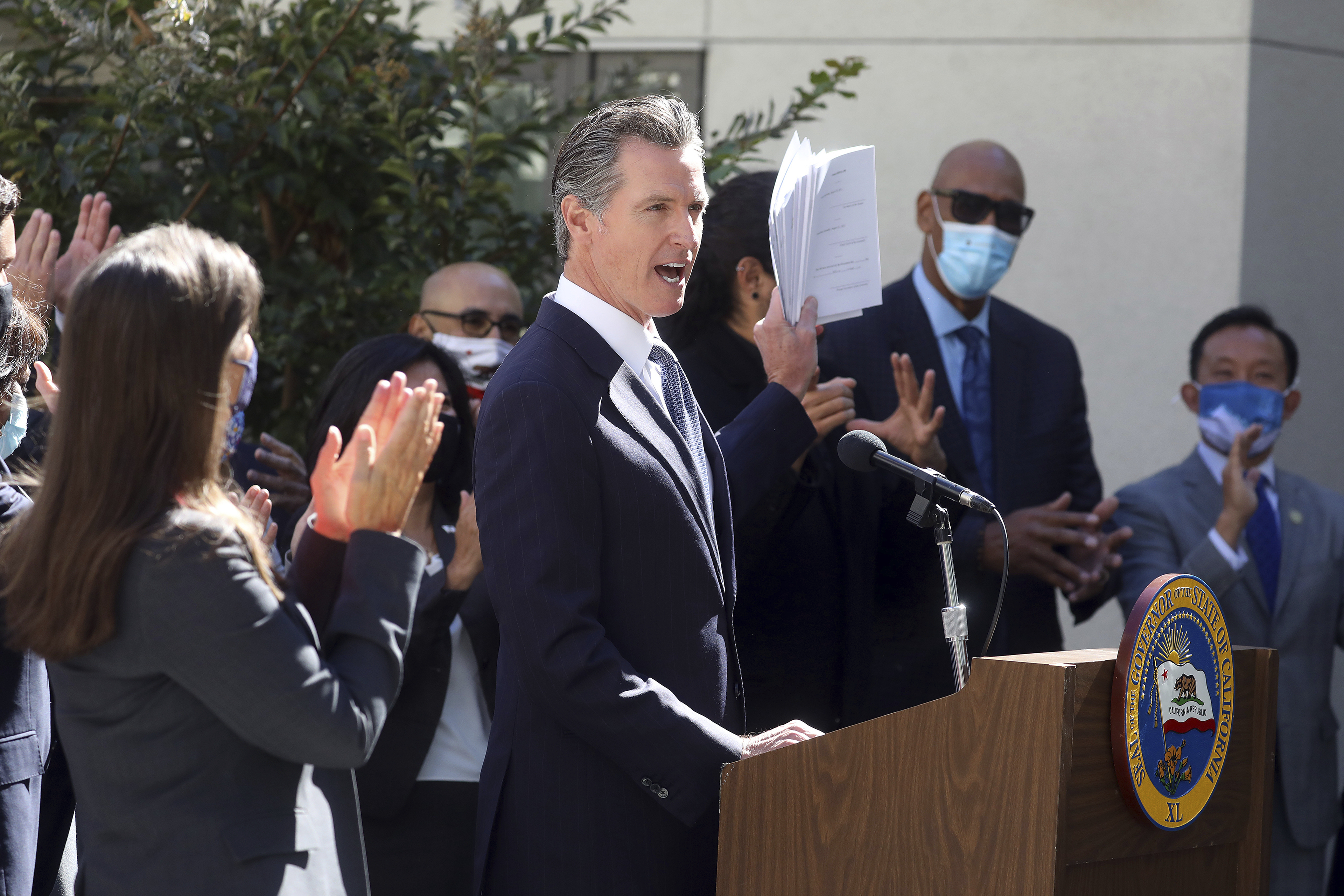 California Gov. Gavin Newsom speaks at a news conference to sign a number of housing bills at the Coliseum Connections apartment complex in Oakland, Calif., Tuesday, Sept. 28, 2021. Newsom signed seven new laws aimed at addressing the state's homeless crisis during an event in Los Angeles, on Wednesday, Sept. 29.