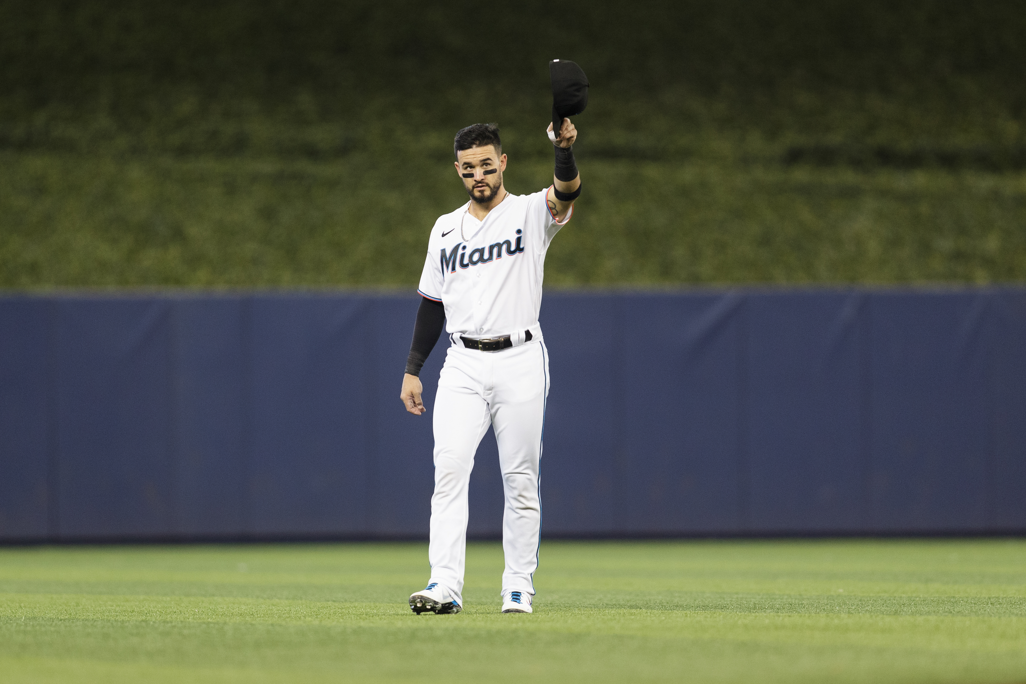 Eddy Alvarez #65 of the Miami Marlins salutes fans before the start of the game against the Pittsburgh Pirates at loanDepot park