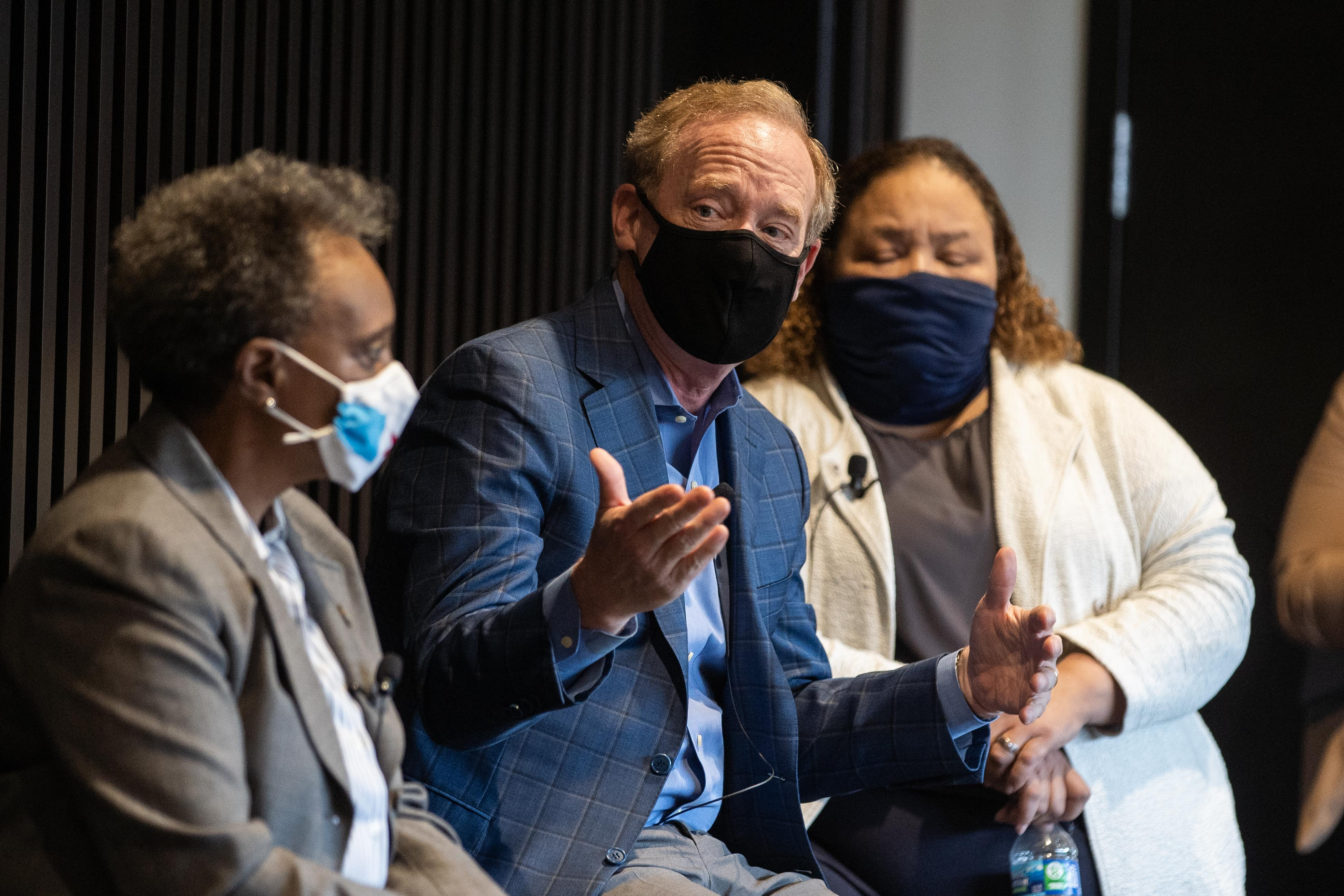 """Microsoft President Brad Smith speaks with Mayor Lori Lightfoot during a launch of Accelerate Chicago at the North Lawndale Employment Network. The program hopes to bridge a digital divide and address systemic inequities.Public and private organizations launched """"Accelerate Chicago,"""" a partnership between Chicago Mayor Lori Lightfoot and Microsoft Corp. that will provide digital skills to job seekers in Chicago, Friday afternoon, Oct. 1, 2021."""