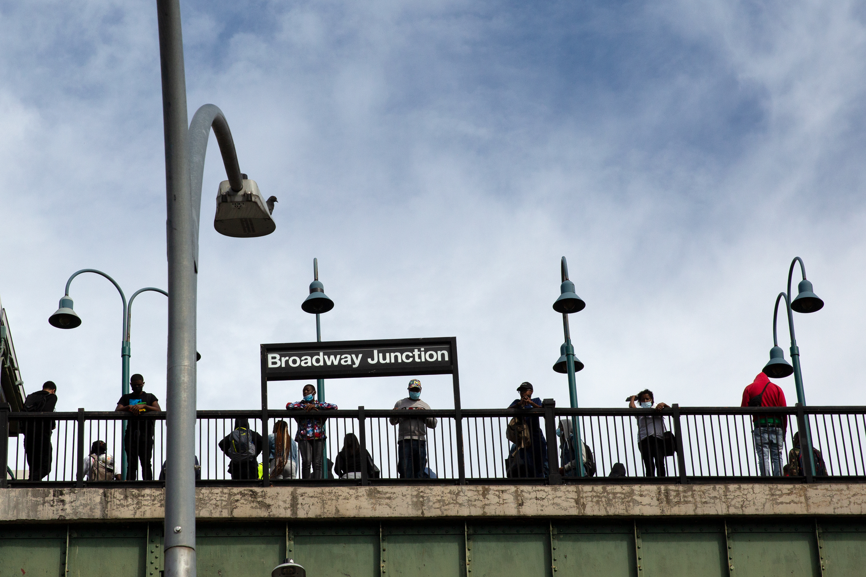 People wait for a train at the Broadway Junction station in Brooklyn, Sept. 22, 2021.