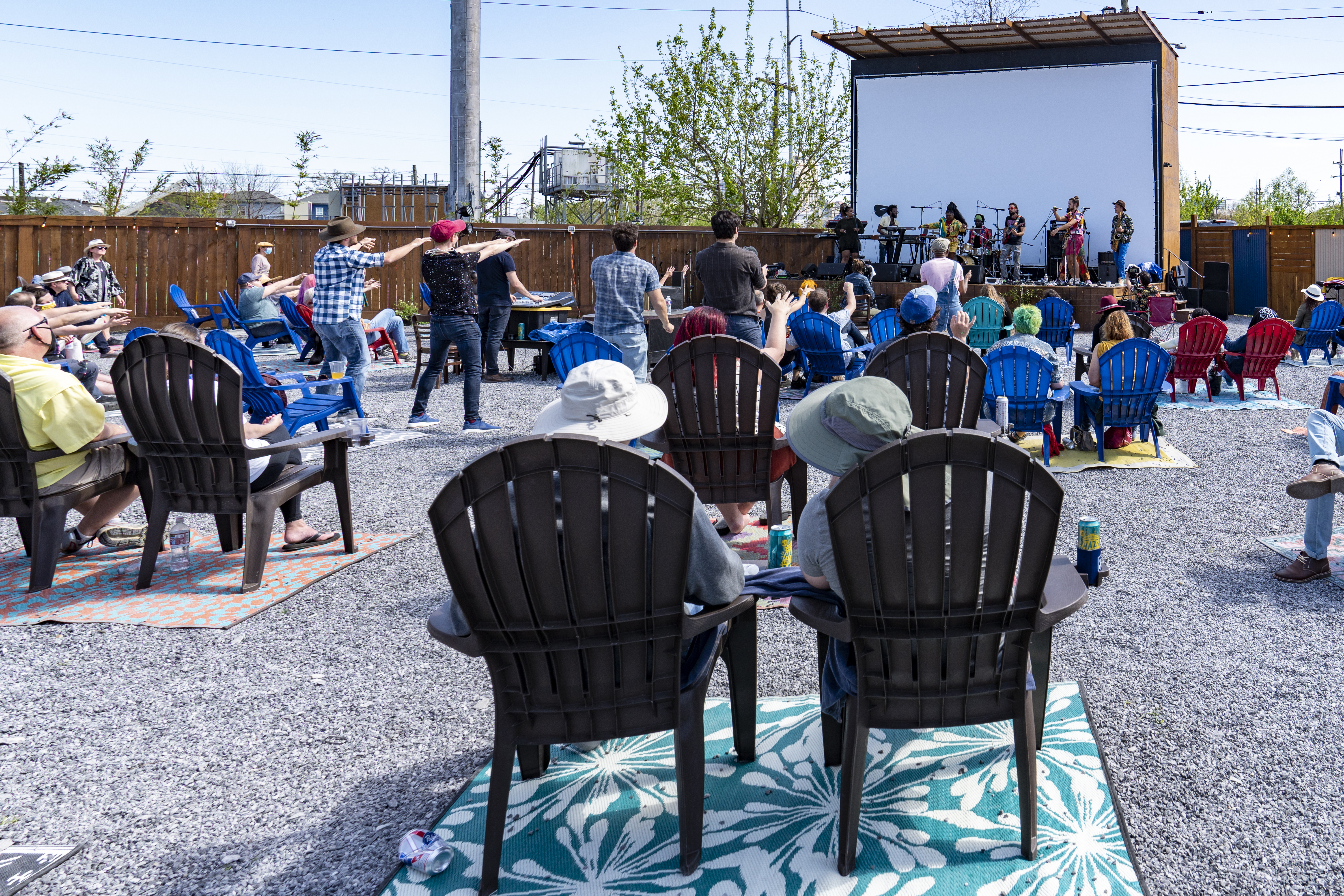 People sit in chairs watching Tank & The Bangas in concert the Broadside New Orleans, an all-outdoor music venue founded during the pandemic