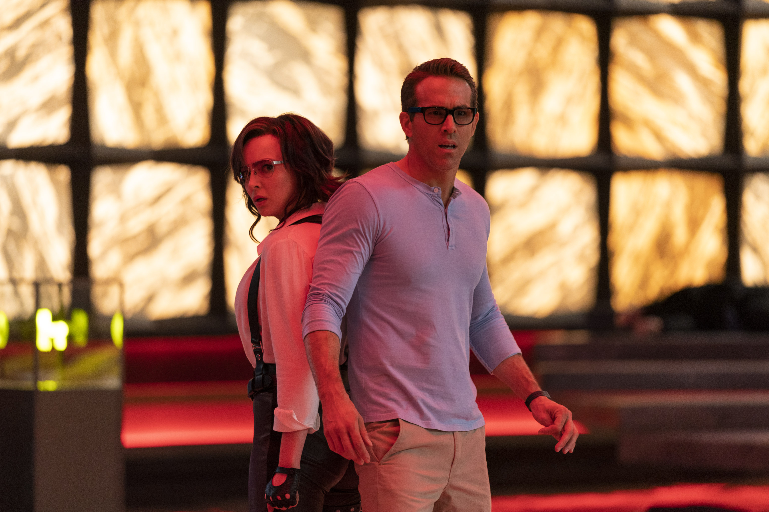 Jodie Comer as Molotov Girl and Ryan Reynolds as Guy in 20th Century Studios' FREE GUY.