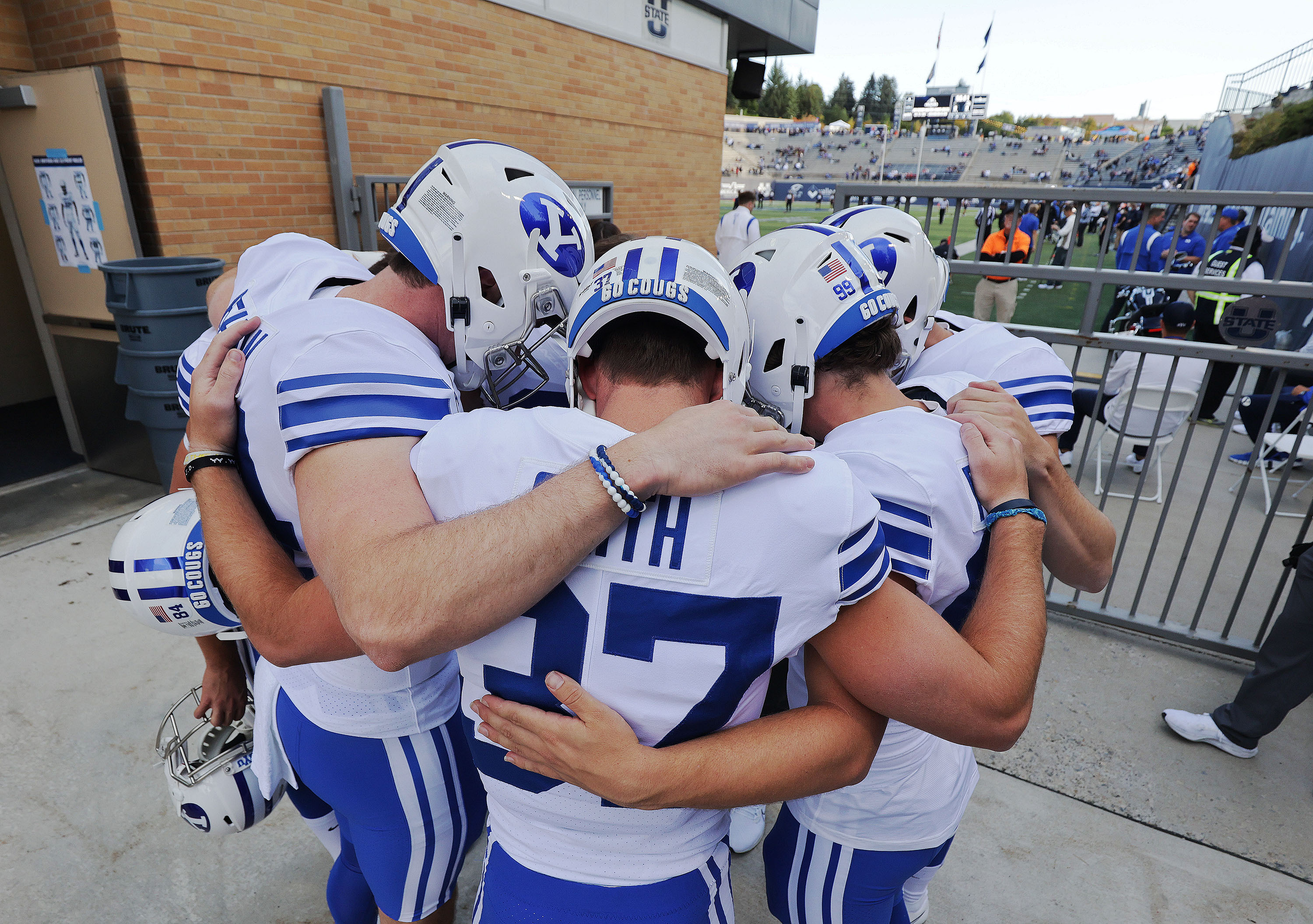 Brigham Young Cougars players pray prior to warming up in Logan.