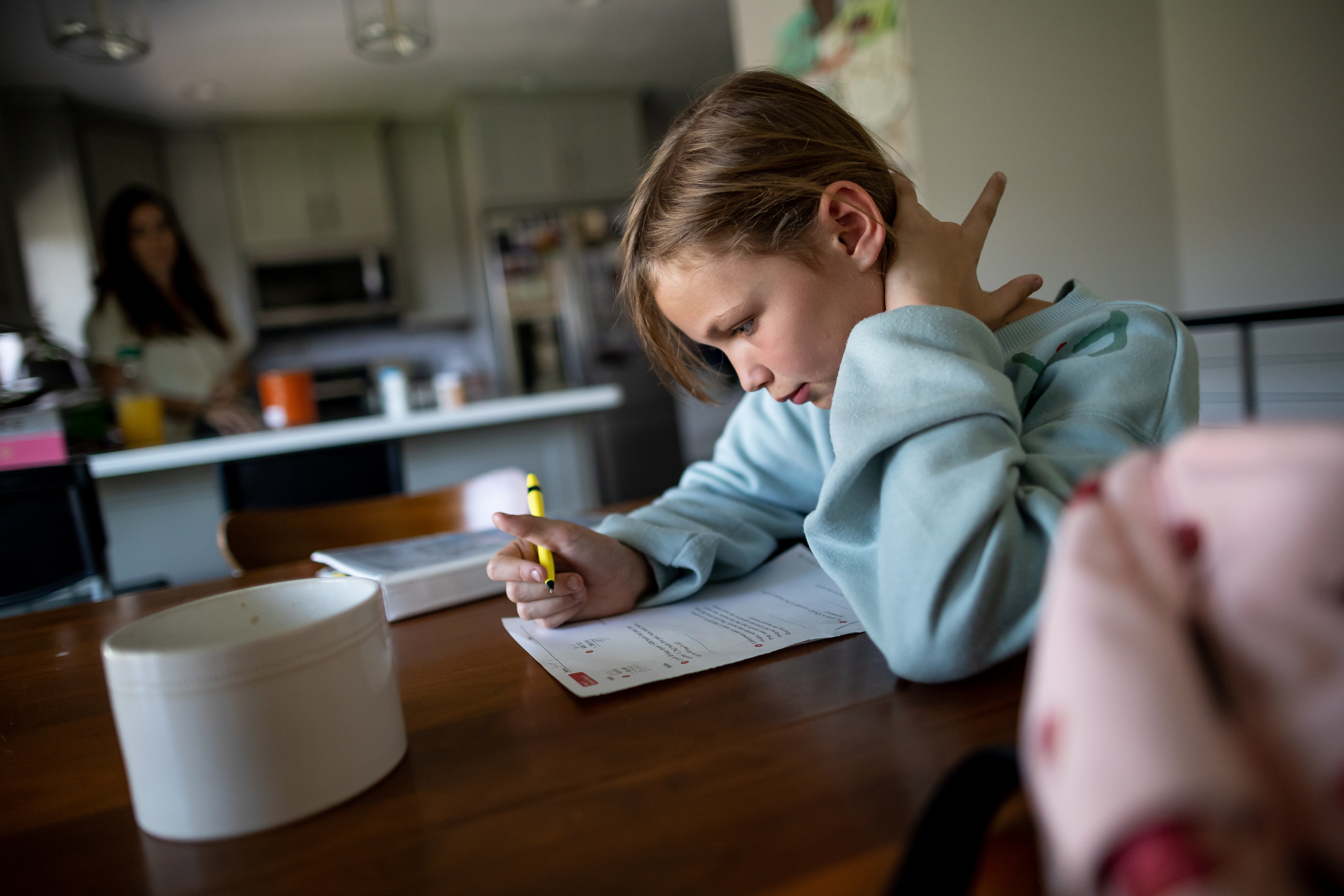 Emery Blackburn, 9, does her homework after returning from school at her home in South Jordan on Tuesday, Sept. 14, 2021.